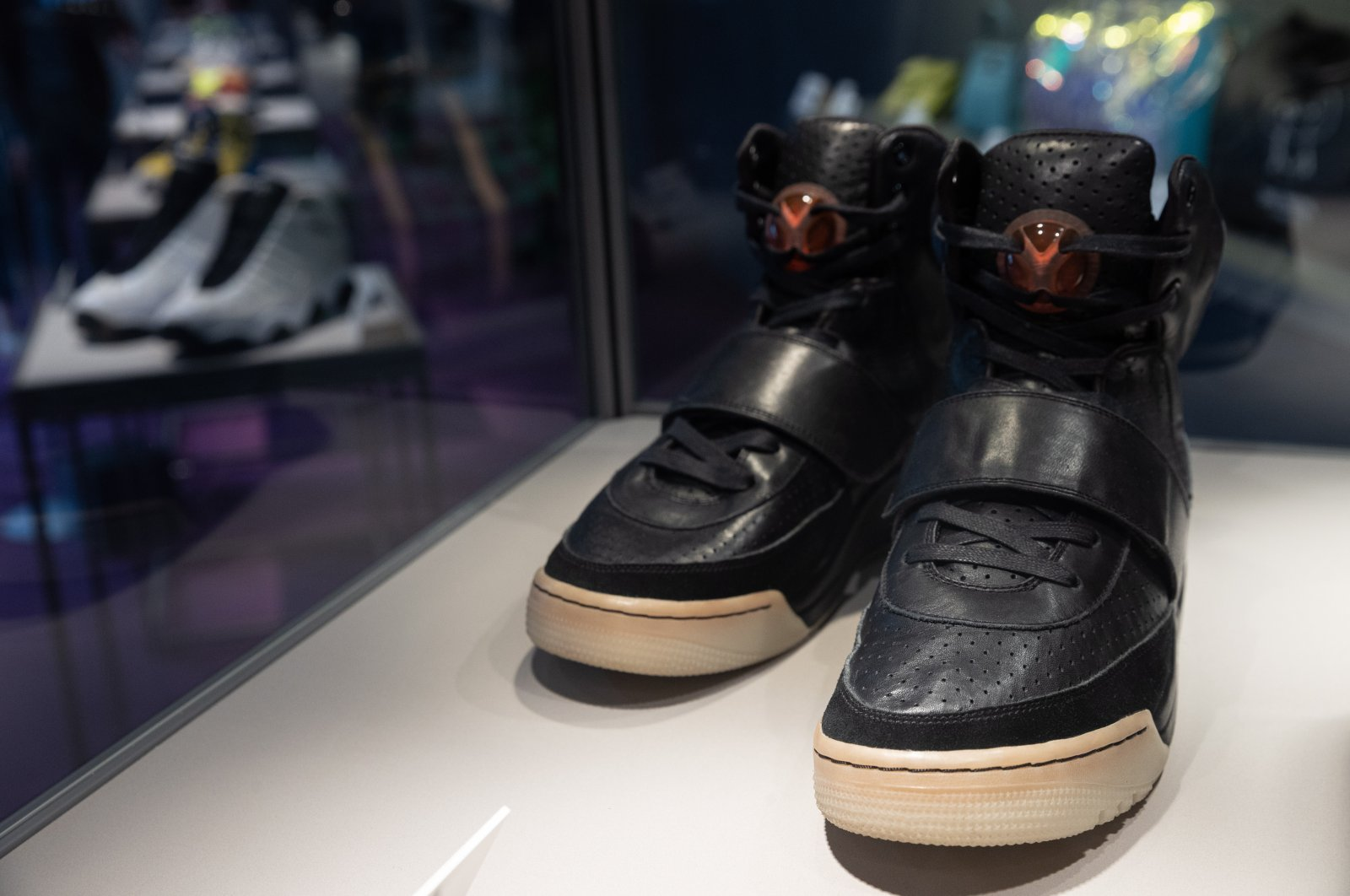 Kanye West 'Grammy Worn' Nike Air Yeezy 1 Prototype sneakers (R) are on display during a Sotheby's auction preview in Hong Kong, China, 17 April 2021. (EPA Photo)