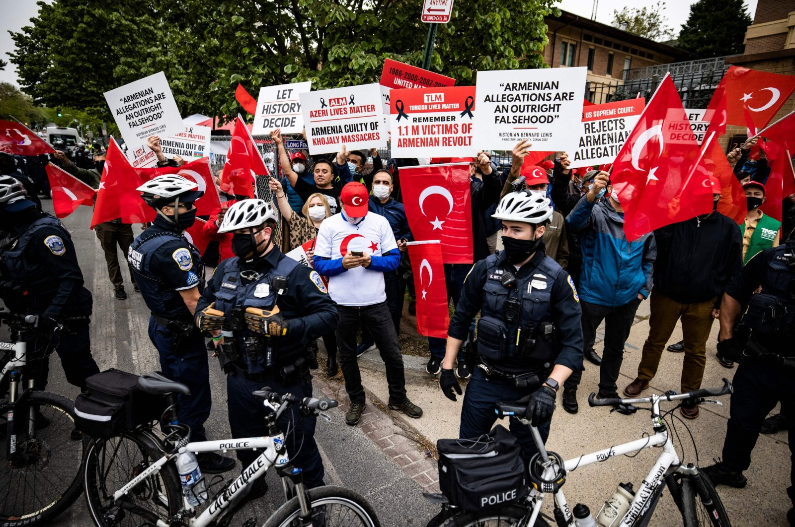 Turkish protesters are kept separated from Armenian protestors to avoid confrontation in front of the Turkish Embassy on the 106th anniversary of the 1915 events, in Washington, D.C., U.S., April 24, 2021. (AFP Photo)