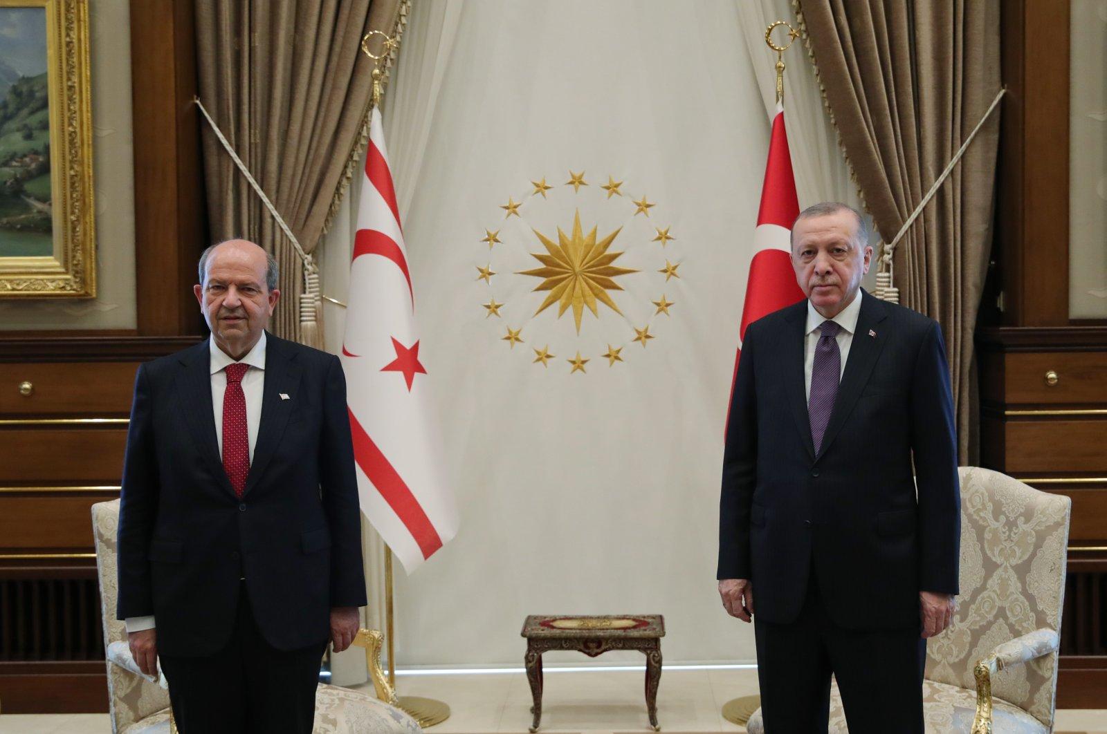 Turkish Republic of Northern Cyprus President Ersin Tatar (L) and President Recep Tayyip Erdoğan pose before a bilateral meeting, Ankara, Turkey, April 26, 2021. (AA Photo)