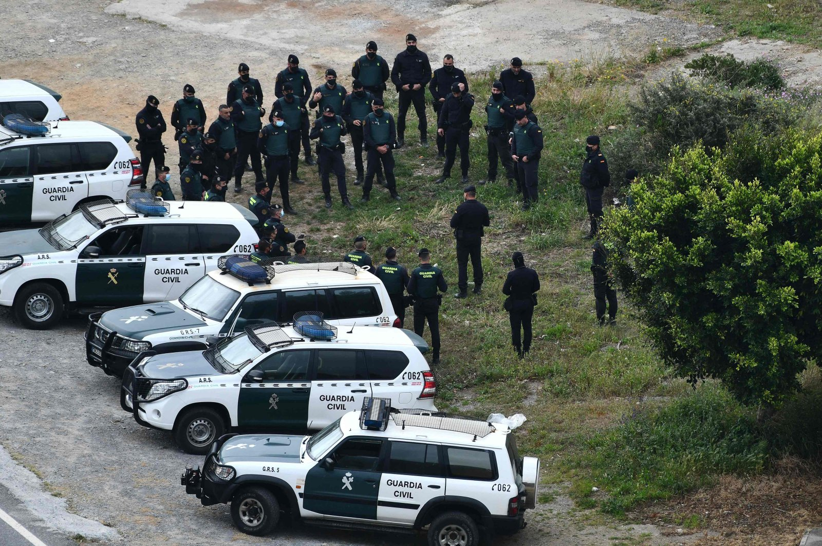 Spanish Guardia Civil members stand guard in the Spanish exclave of Ceuta bordering Morocco, after an attempt by migrants to breach the border fence, April 13, 2021. (AFP)