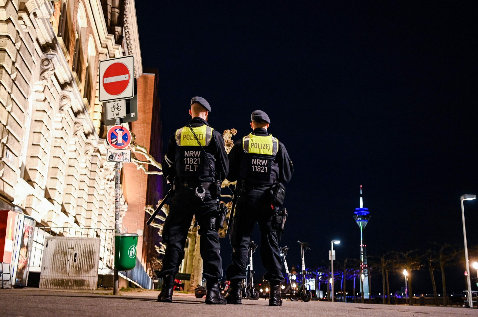 Police officers patrol at the Rhine promenade during exit restrictions in Duesseldorf, western Germany, on April 24, 2021, amid the novel coronavirus / COVID-19 pandemic. (AFP File Photo)