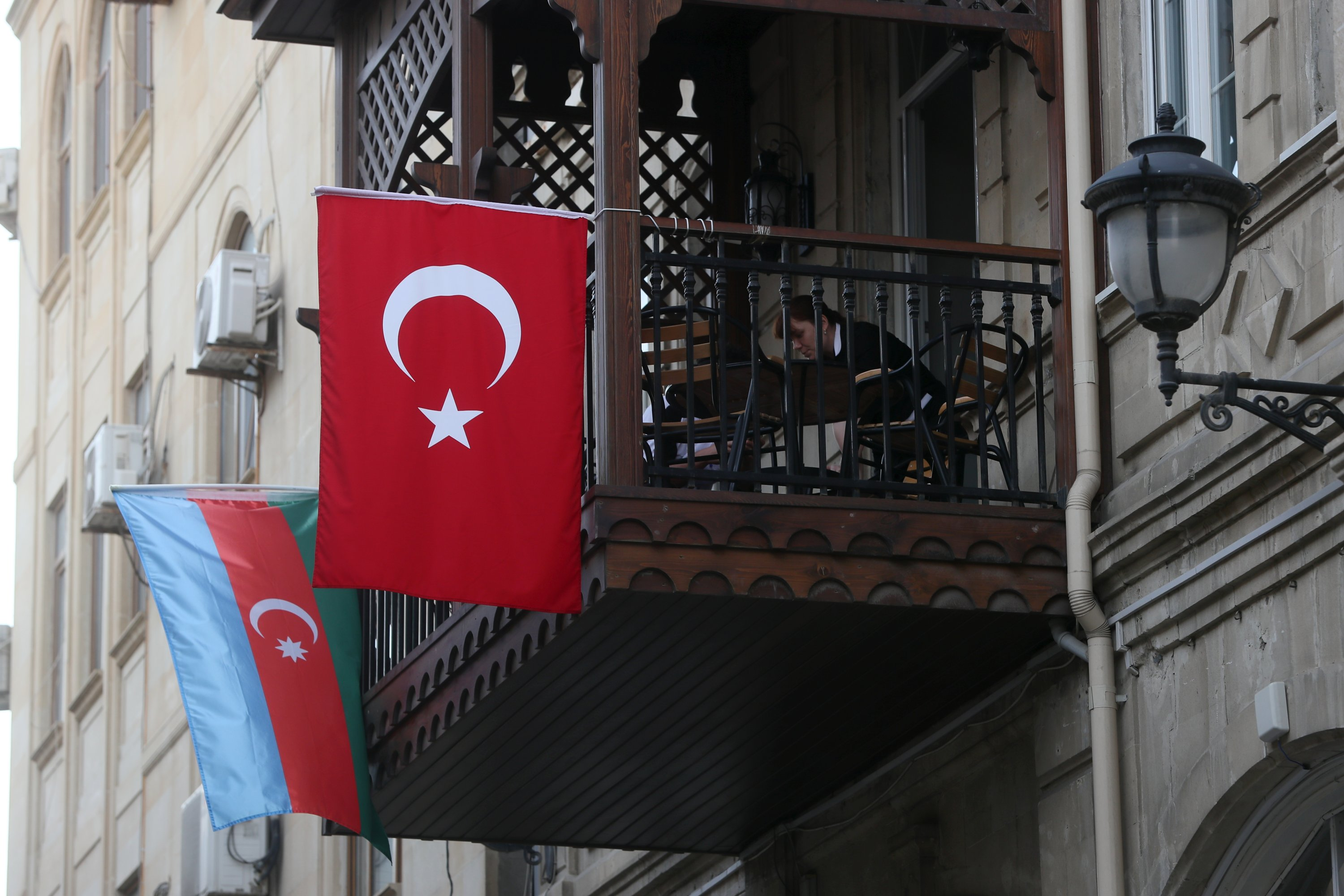 The national flags of Turkey and Azerbaijan hang from a balcony, Baku, Azerbaijan, Oct. 23, 2020. (Photo by Getty Images)