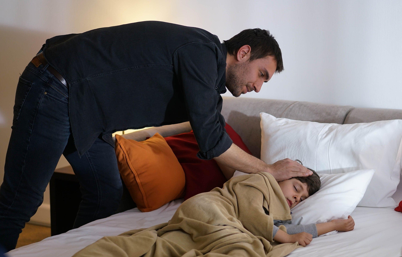 A still shot from 'Sen Anlat Karadeniz' shows actor Ulaş Tuna Astepe as Tahir (L) and Demir Birinci as Yiğit.