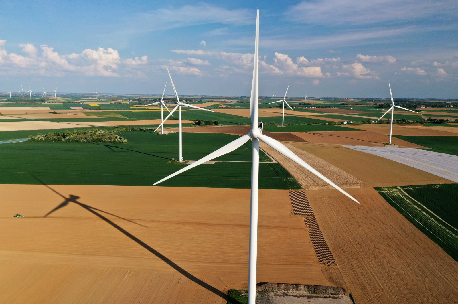 An aerial view shows power-generating windmill turbines in a wind farm in Graincourt-les-Havrincourt, France, April 27, 2020. (Reuters Photo)