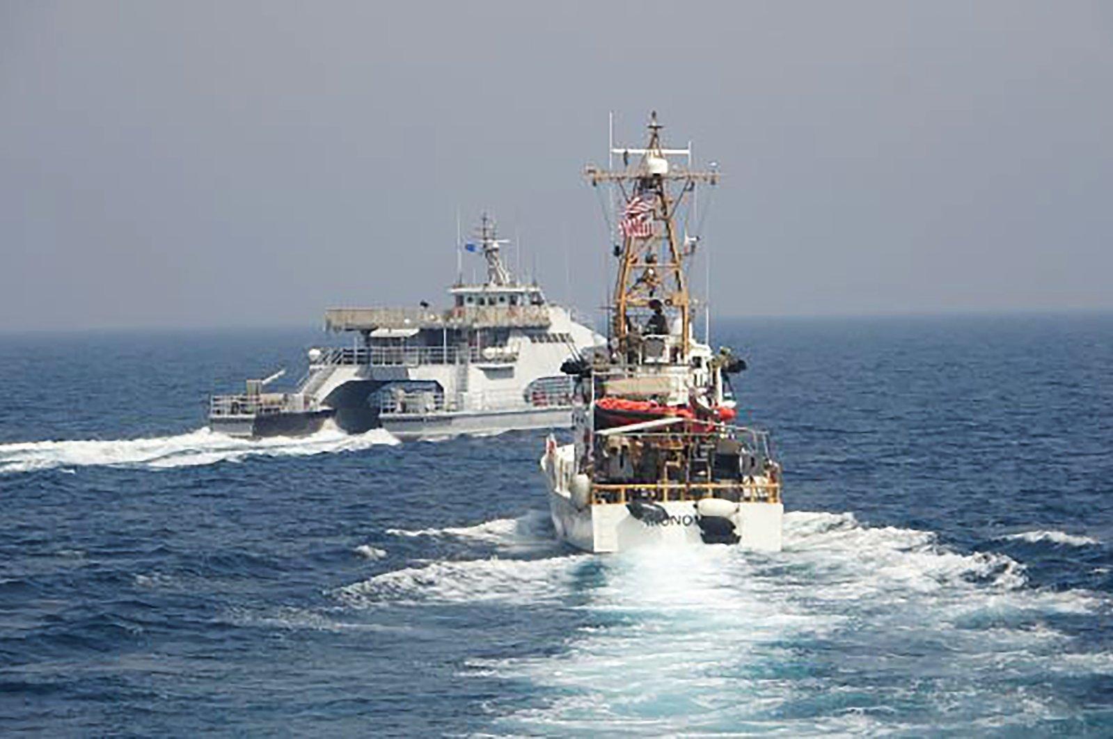 An Iranian Revolutionary Guard vessel cuts in front of the U.S. Coast Guard ship USCGC Monomoy in the Persian Gulf, April 2, 2021, (U.S. Navy via AP Photo)