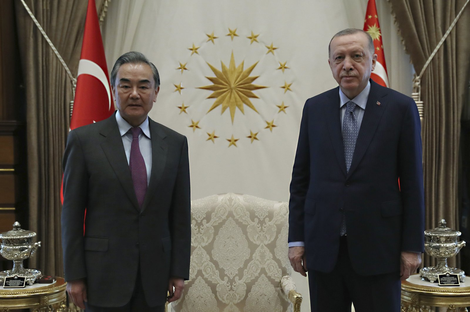 President Recep Tayyip Erdoğan (R) and Chinese Foreign Minister Wang Yi pose for photos before a meeting, in Ankara, Turkey, March 25, 2021. (AP Photo)