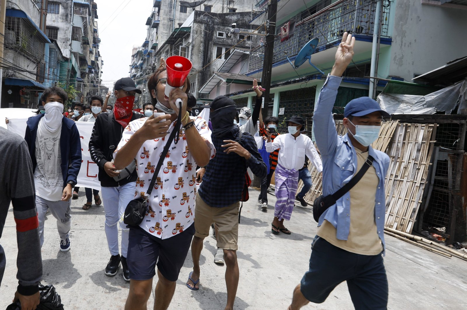 Demonstrators shout slogans and flash the three-fingers salute during an anti-military coup protest in Yangon, Myanmar, April 27, 2021. (EPA Photo)