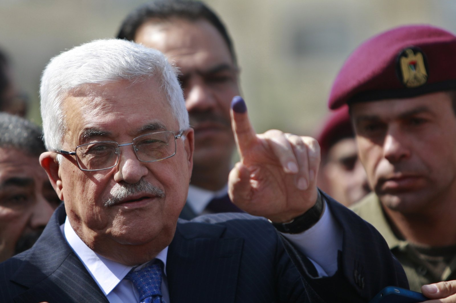 Palestinian President Mahmoud Abbas shows his ink-stained finger after casting his vote during local elections, at a polling station in the West Bank city of Ramallah, Oct. 20, 2012. (AP Photo)