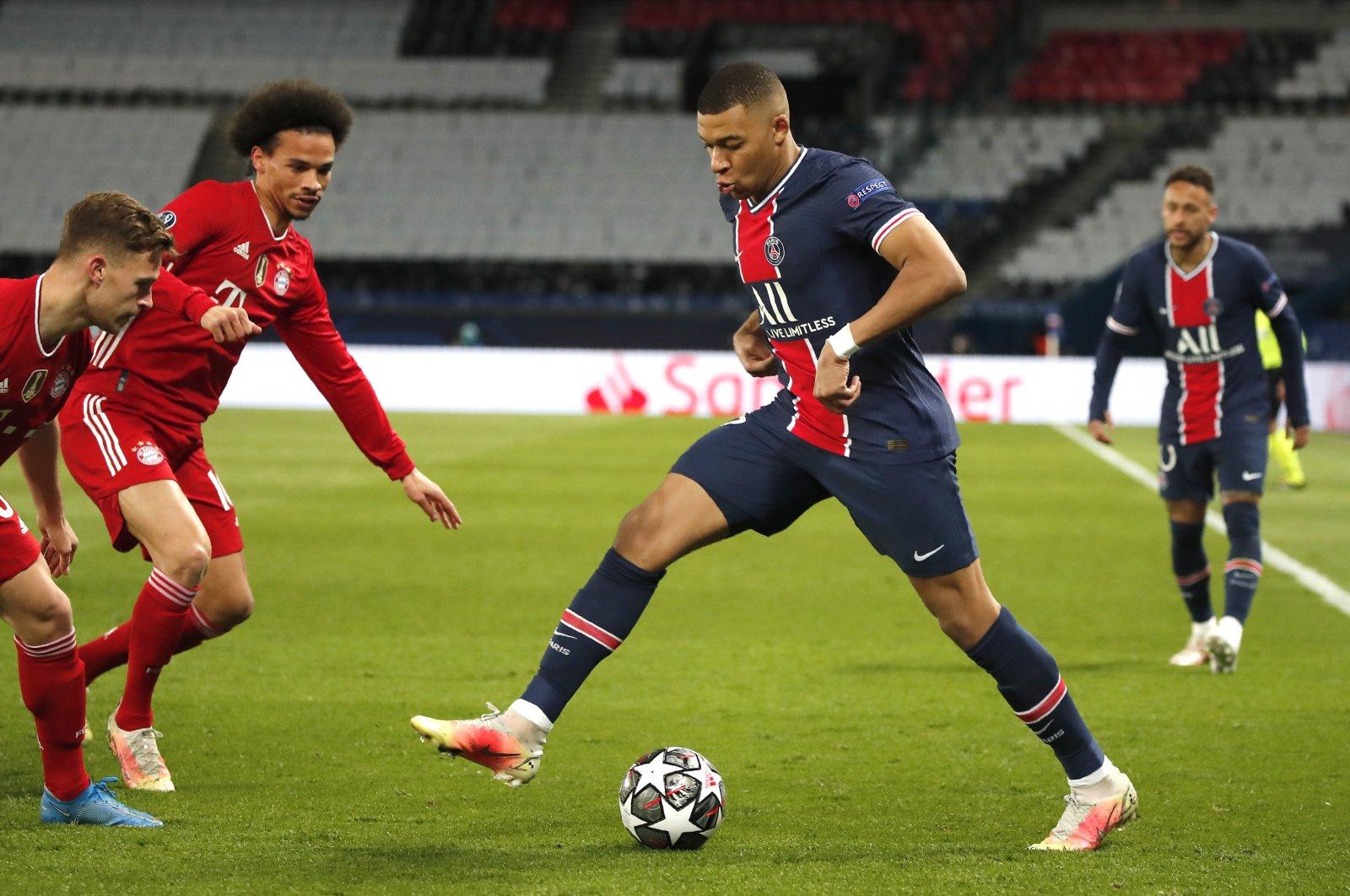 PSG's Kylian Mbappe controls the ball during the Champions League, second leg, quarterfinal match against Bayern Munich at the Parc des Princes stadium, Paris, France, April 13, 2021. (AP Photo)