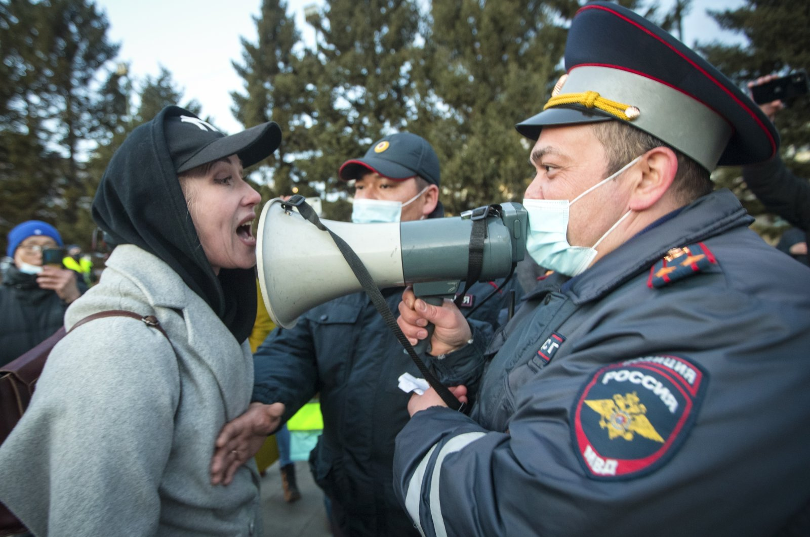 A woman argues with a police officer during a protest in support of jailed opposition leader Alexei Navalny in Ulan-Ude, the regional capital of Buryatia, a region near the Russia-Mongolia border, Russia, April 21, 2021. (AP Photo)