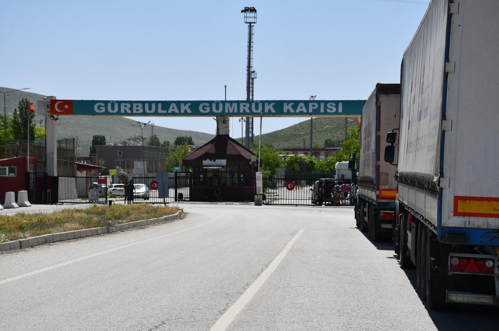 Trucks loaded with goods seen at the Gürbulak Border Gate on the Turkey-Iran border, Ağrı province, eastern Turkey, April 6, 2020. (AA Photo)