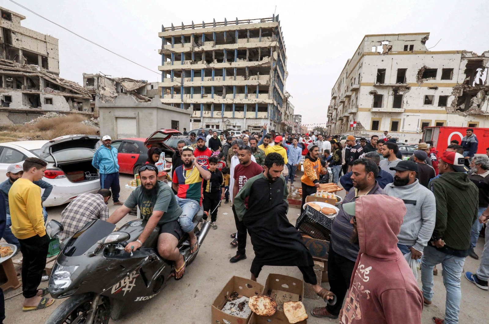 People shop at the Suq al-Hout (Whale Market) district during the Muslim holy month of Ramadan in the eastern city of Benghazi, Libya, on April 18, 2021. (AFP)