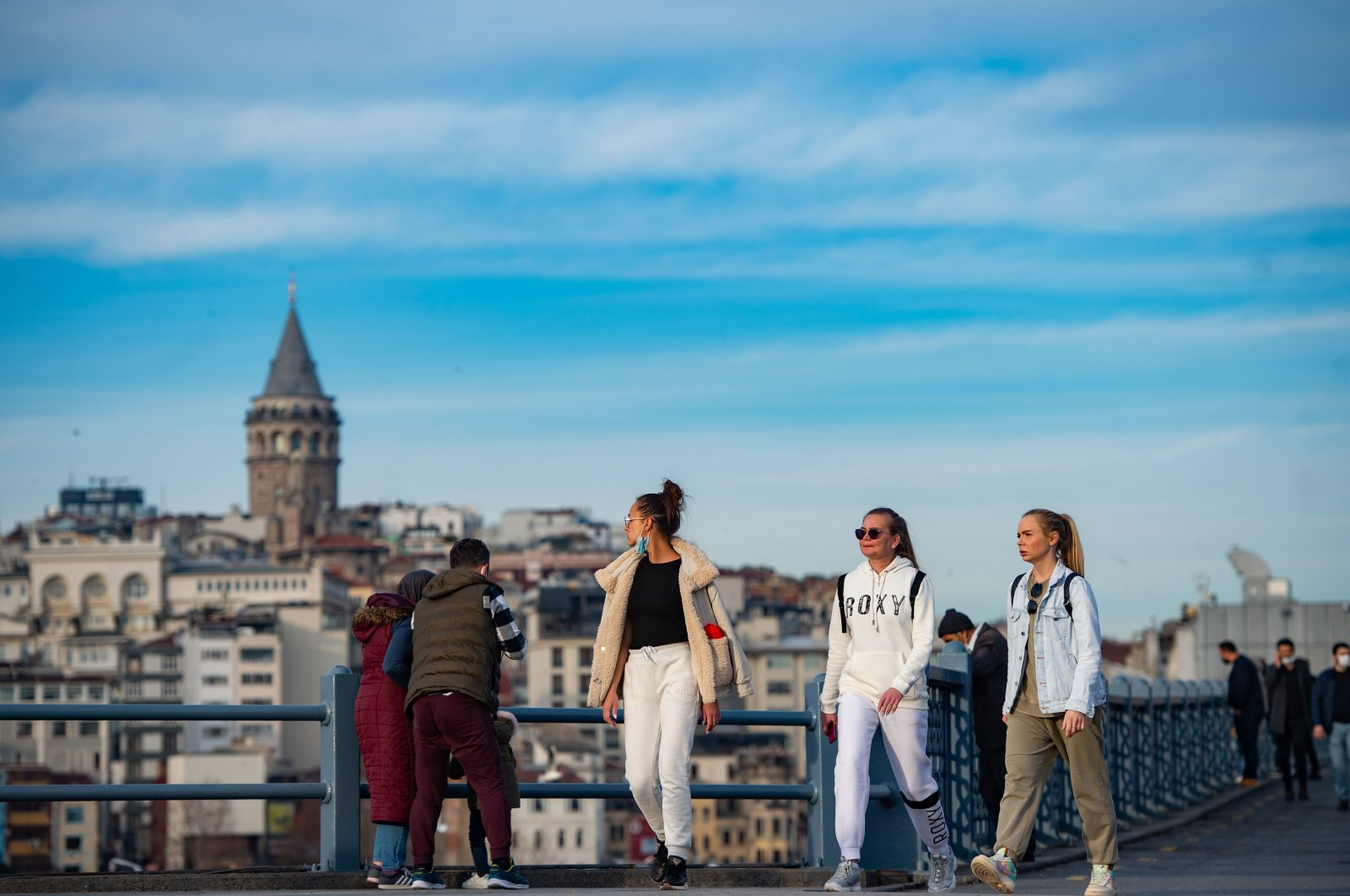 Tourists walk near Galata Bridge during a two-day curfew to limit the spread of COVID-19 in Istanbul, Turkey, Jan. 31, 2021. (AFP Photo)