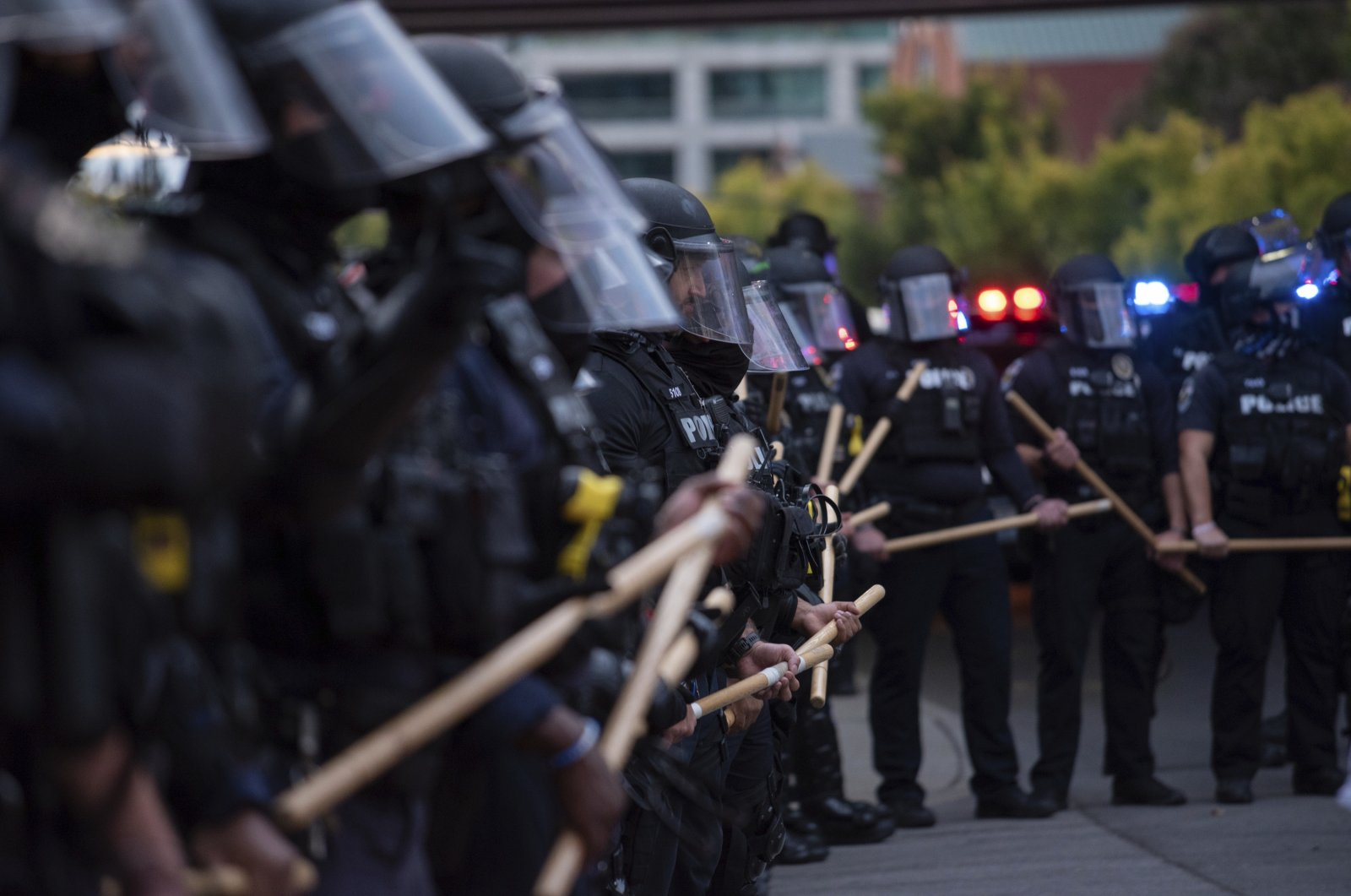 A line of police officers block protesters in Louisville, Kentucky, U.S., Sept. 25, 2020. (AP Photo)