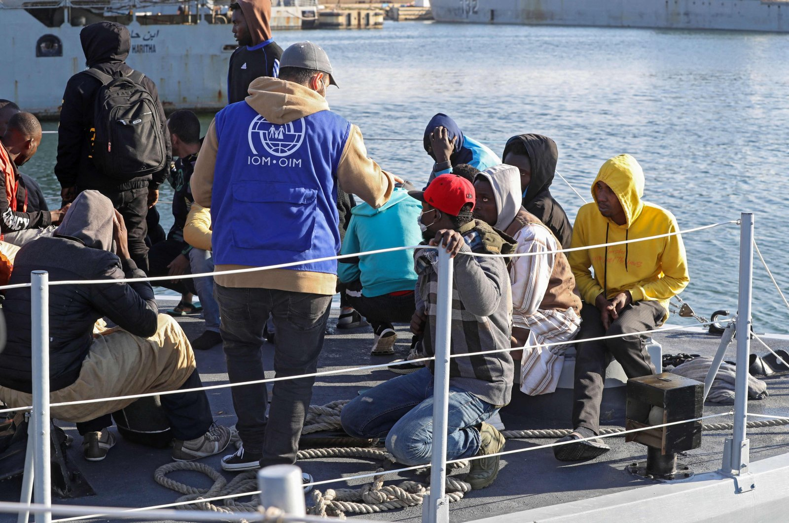 Migrants arrive at a naval base in the Libyan capital of Tripoli after the coastguard intercepted an inflatable boat carrying 138 Europe-bound migrants off its west coast, Tripoli, Libya, March 31, 2021. (AFP File Photo)