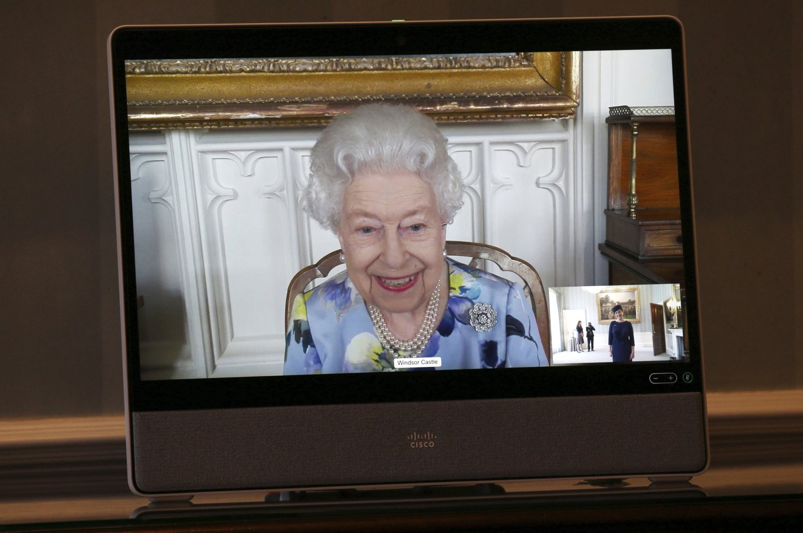 Britain's Queen Elizabeth II appears on a screen by videolink from Windsor Castle, during a virtual audience to receive Her Excellency Ivita Burmistre, the Ambassador of Latvia, at Buckingham Palace, London, U.K., April 27, 2021. (AP Photo)