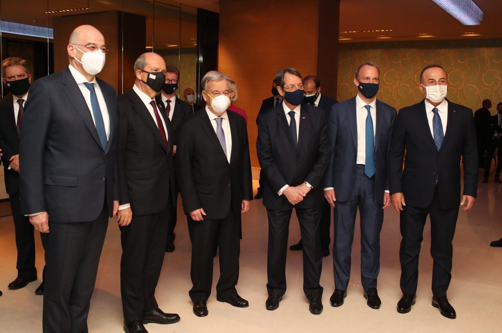 TRNC President Tatar (2-L), Foreign Minister Çavuşoğlu (R) UN chief Guterres (3-L), UK FM Raab (2-R), Greek FM Dendias (L) and Greek Cypriot leader Anastasiades (3-R) meet in Geneva on Apr. 27, 2021 (AA Photo)