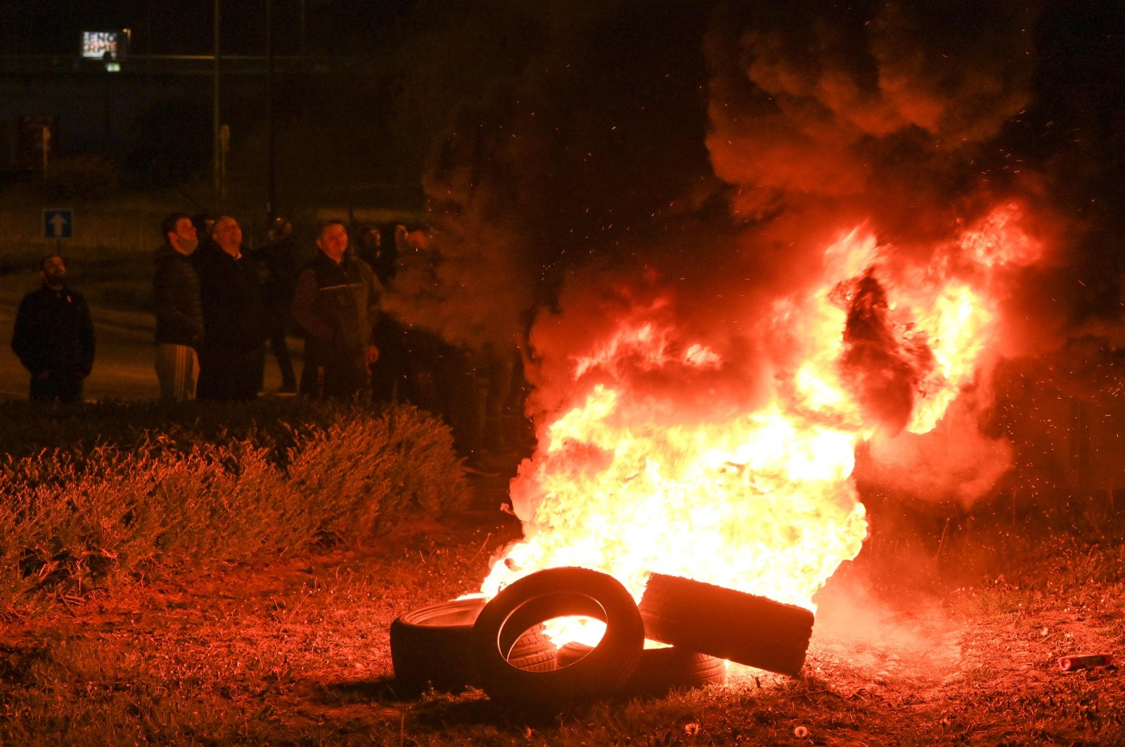 French fishermen stand near burning tyres as they gather as part of a protest action against the delay in granting licenses to access British waters at the port of Boulogne-sur-Mer on April 22, 2021. (AFP Photo)