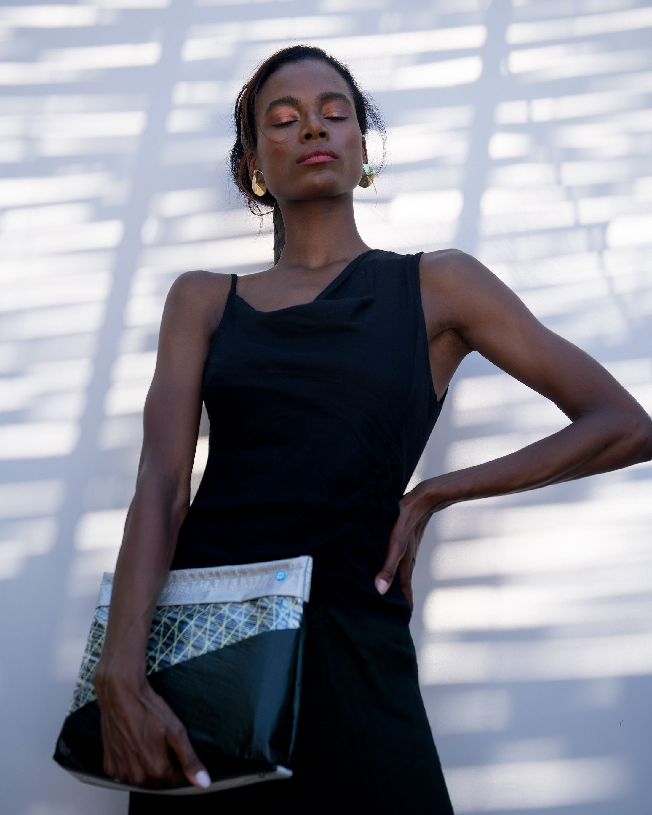A model poses with one of the bags Huner the Brand created from old sailcloth. (Photo courtesy of Hüner Aldemir)