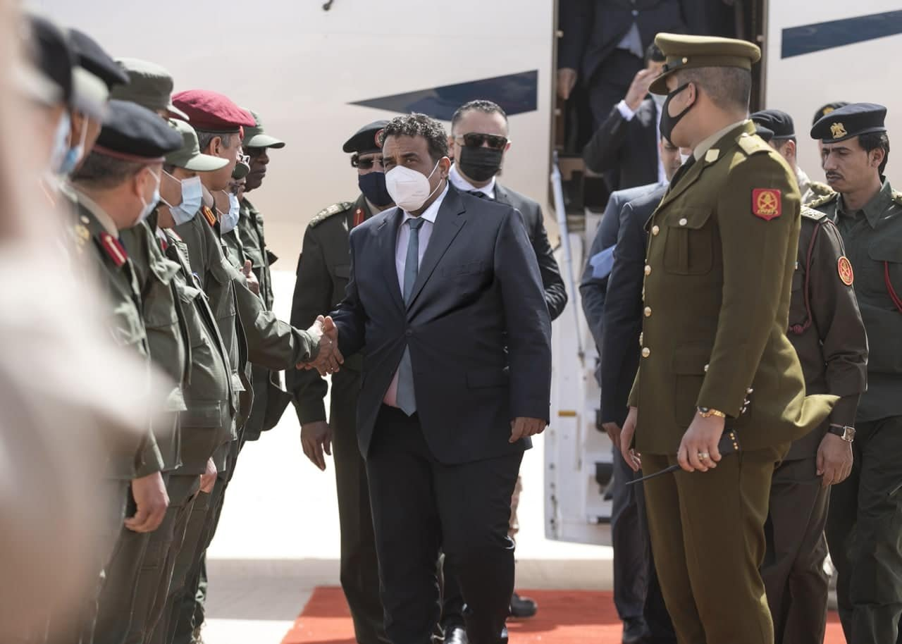 The head of Libya's Presidential Council Mohammad Younes Menfi is welcomed by a military commission, Libya, April 27, 2021. (AA Photo)