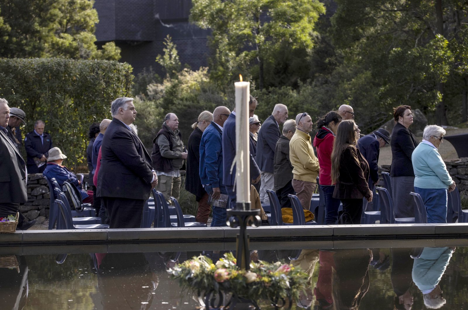 People attend a ceremony at Port Arthur as Australia marks the 25th anniversary of a lone gunman killing 35 people in Tasmania state in a massacre that galvanized the nation into tightening gun laws, Tasmania, Australia, April 28, 2021. (Pool via AP)