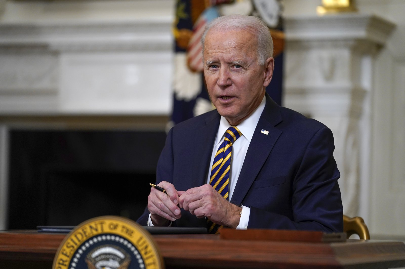 U.S. President Joe Biden pauses after signing an executive order relating to U.S. supply chains, in the State Dining Room of the White House in Washington, U.S., Feb. 24, 2021. (AP Photo)