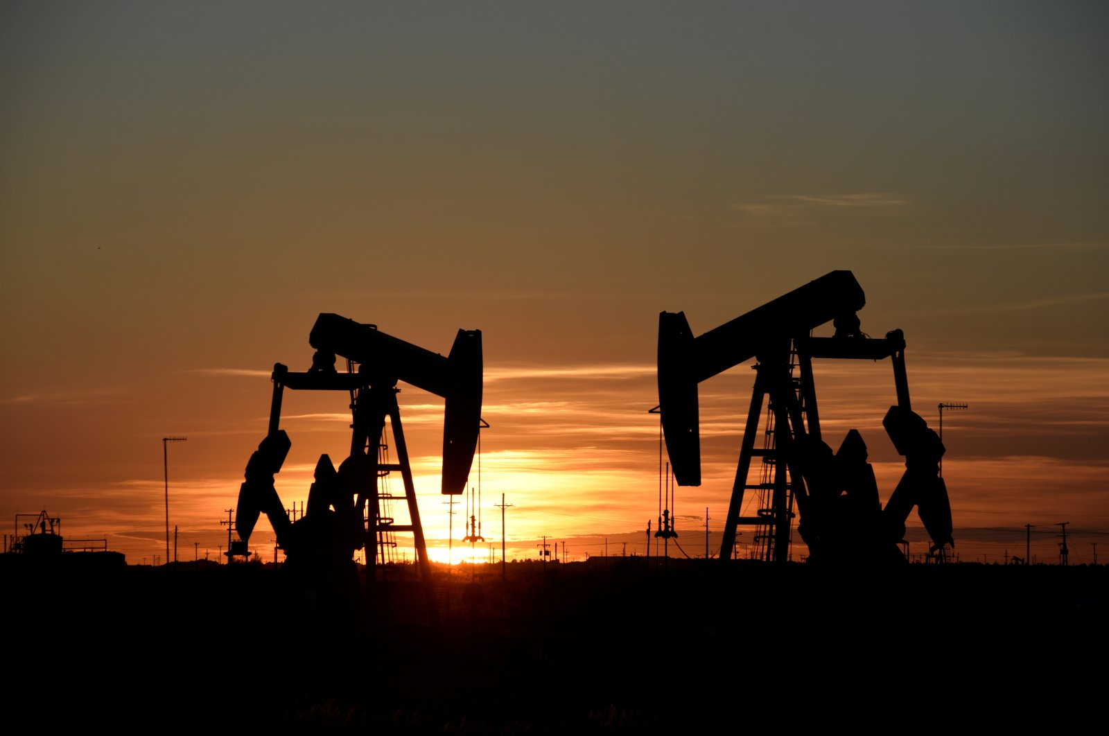 Pump jacks operate at sunset in an oil field in Midland, Texas, U.S., Aug. 22, 2018. (Reuters Photo)