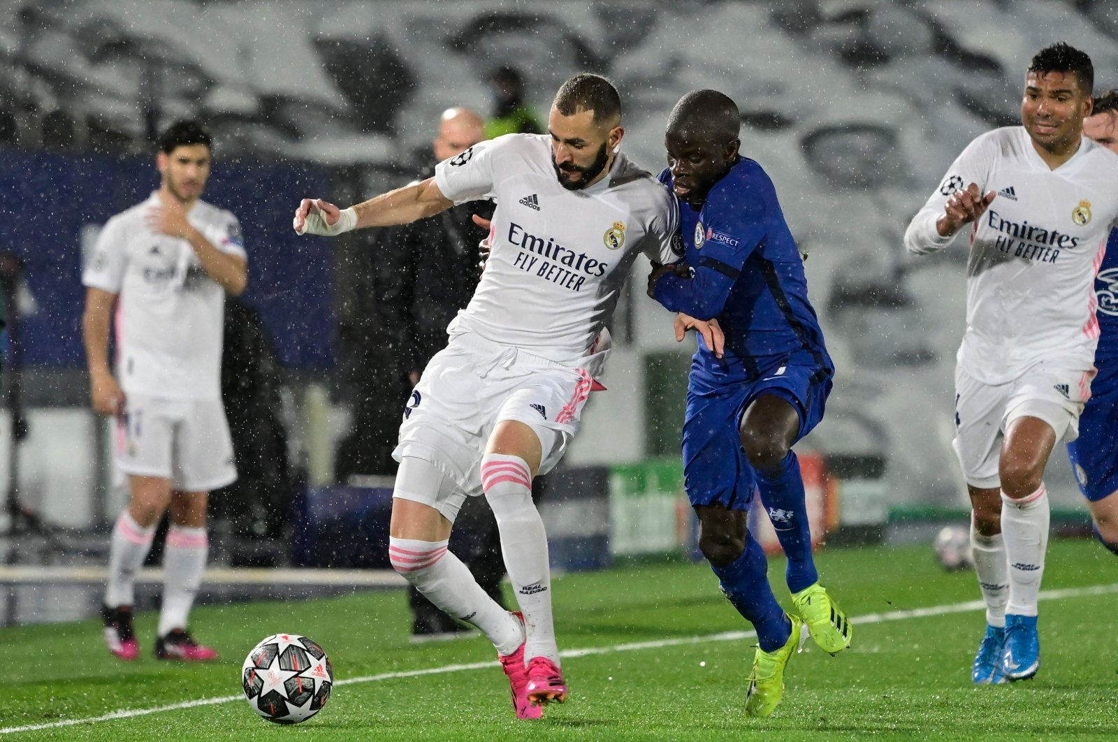 Chelsea's French midfielder N'Golo Kante (2nd R) challenges Real Madrid's French forward Karim Benzema during the UEFA Champions League semifinal first leg match at the Alfredo di Stefano Stadium, Madrid, Spain, April 27, 2021. (AFP Photo)