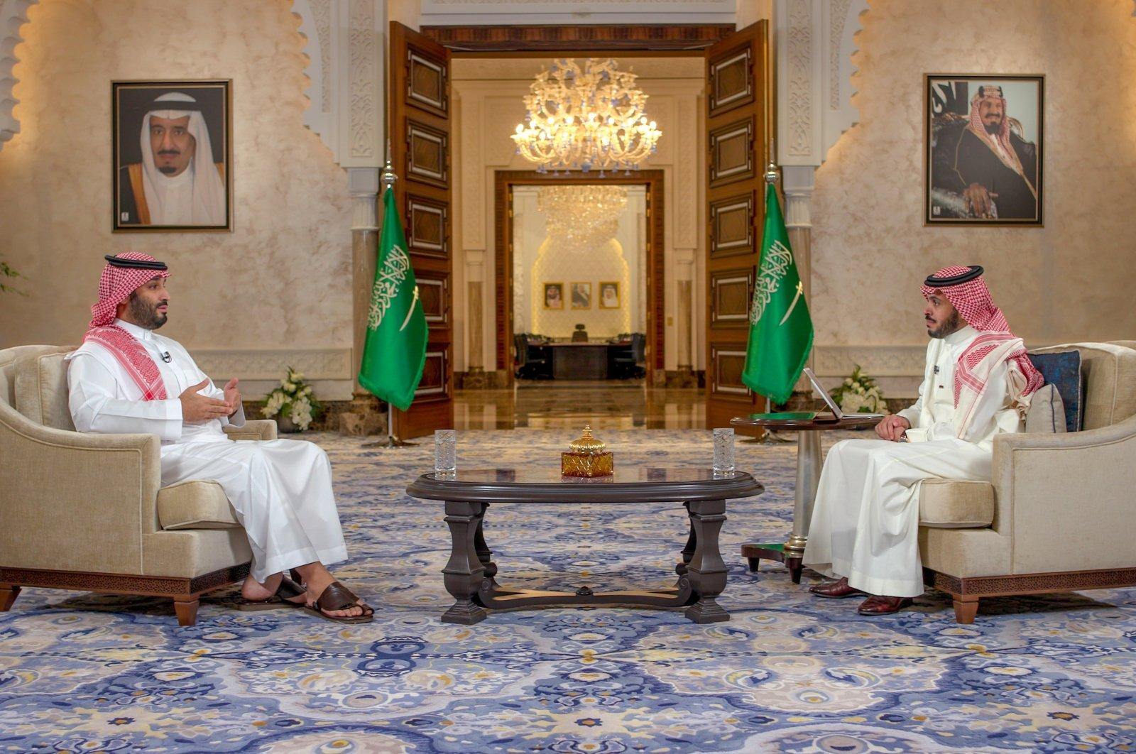Saudi Arabia's Crown Prince Mohammed bin Salman (L) speaks during an interview, Riyadh, Saudi Arabia, April 28, 2021. (AA Photo)
