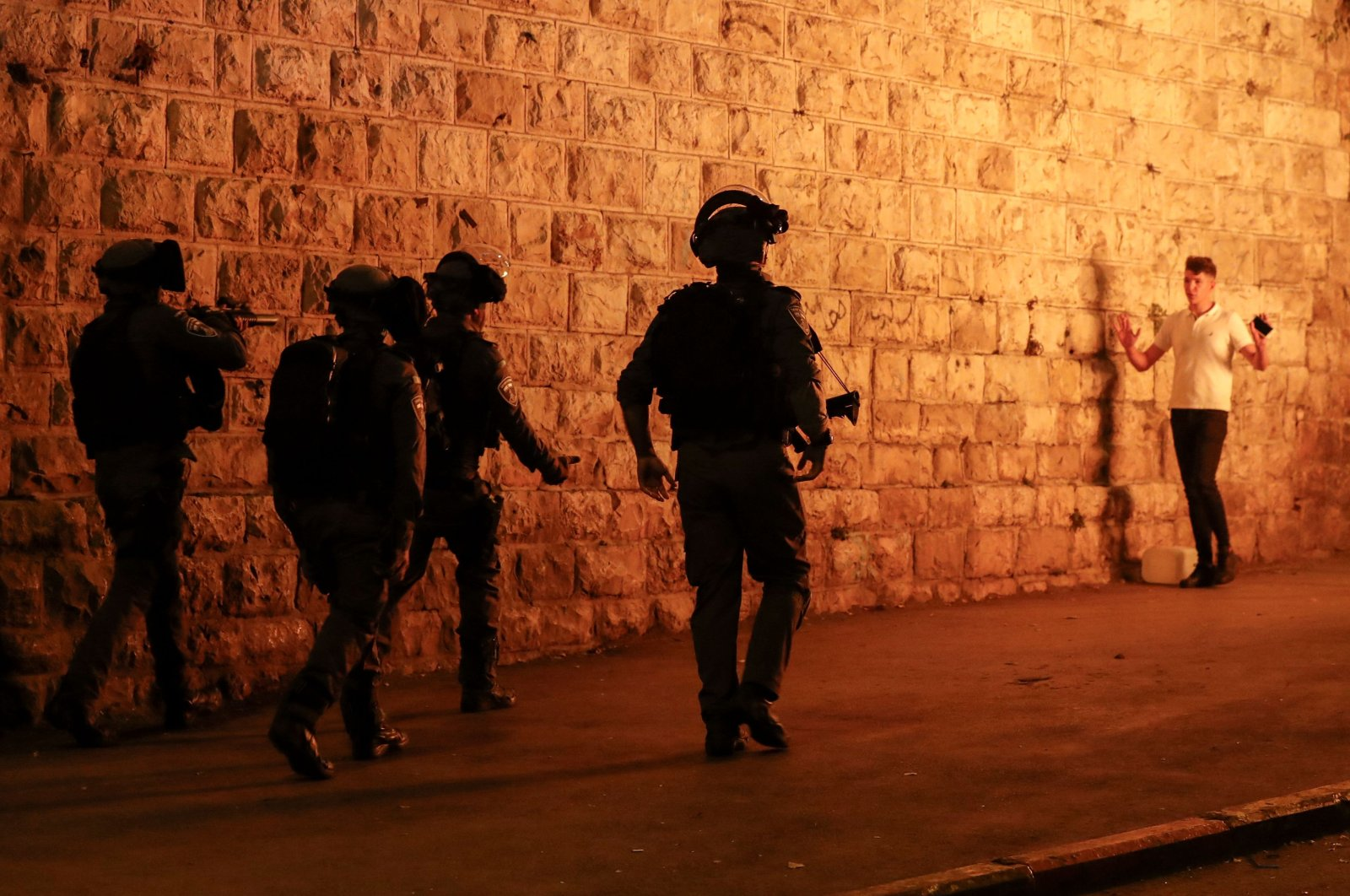 Israeli security forces approach a Palestinian protester outside the Damascus Gate in Jerusalem's Old City, April 23, 2021. (AFP Photo)