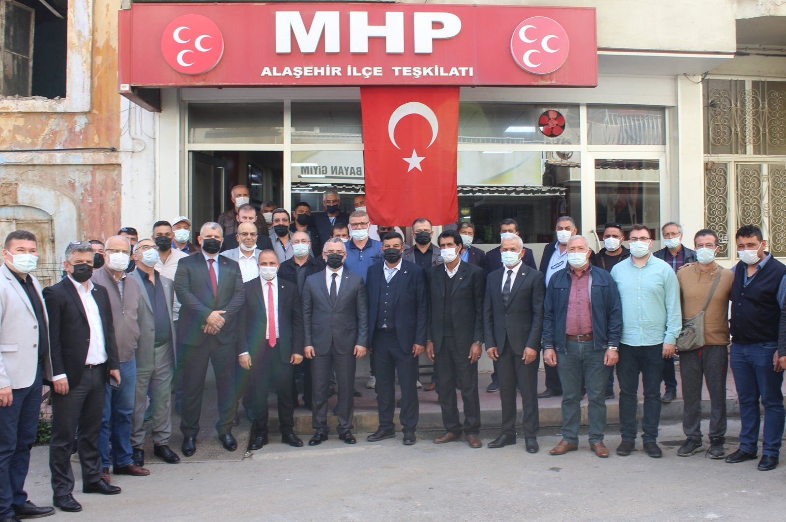 Resigned Good Party (IP) members pose with the local Nationalist Movement Party (MHP) organization in western Manisa province, Turkey, April 28, 2021. (AA Photo)