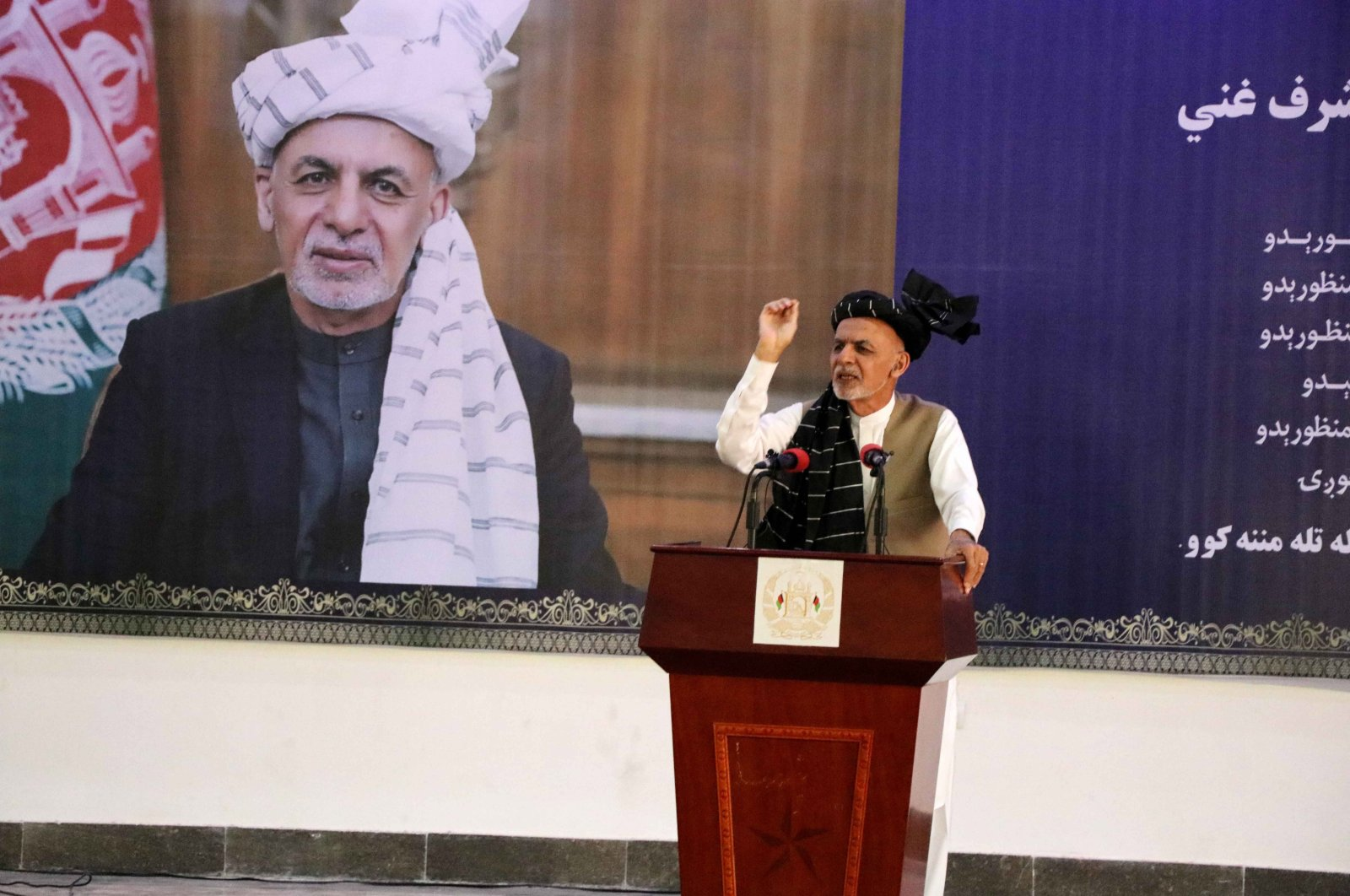 Afghan President Ashraf Ghani (C) talks with supporters during his visit to Kandahar, Afghanistan, April 22, 2021. (EPA Photo)