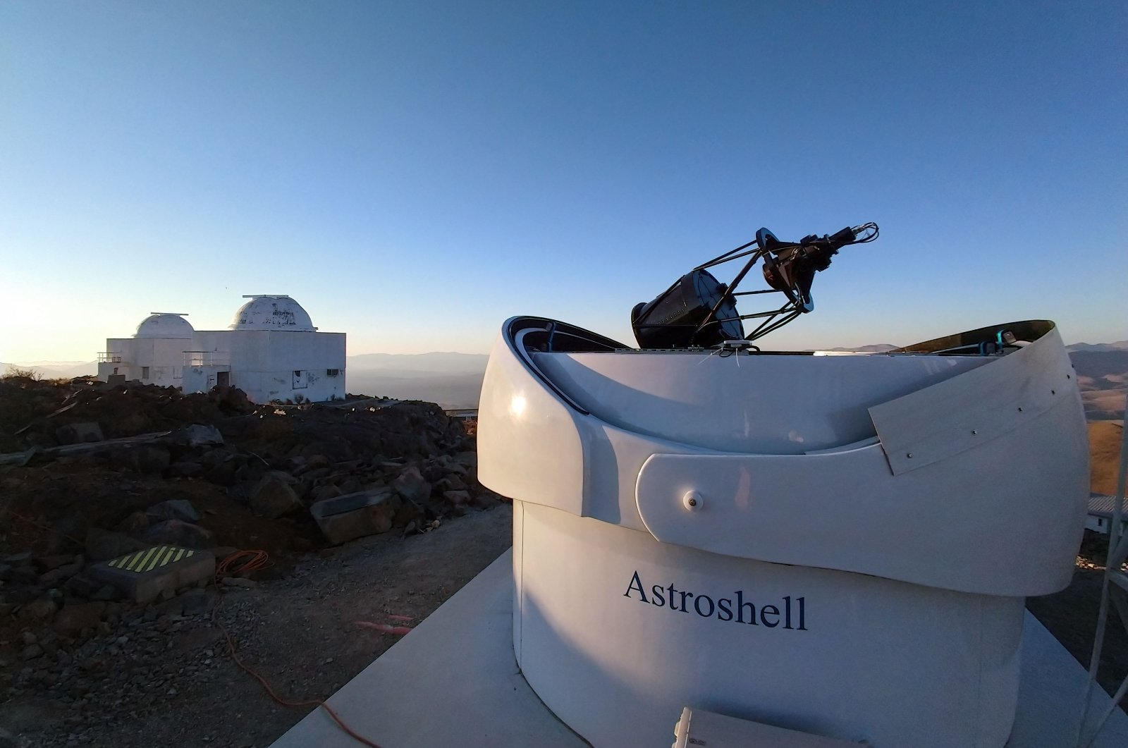 The open dome of European Space Agency's Test-Bed Telescope 2 can be seen among its fellow telescopes at European Southern Observatory's La Silla Observatory in La Higuera, Coquimbo, Chile, April 27, 2021. (European Southern Observatory via AFP)