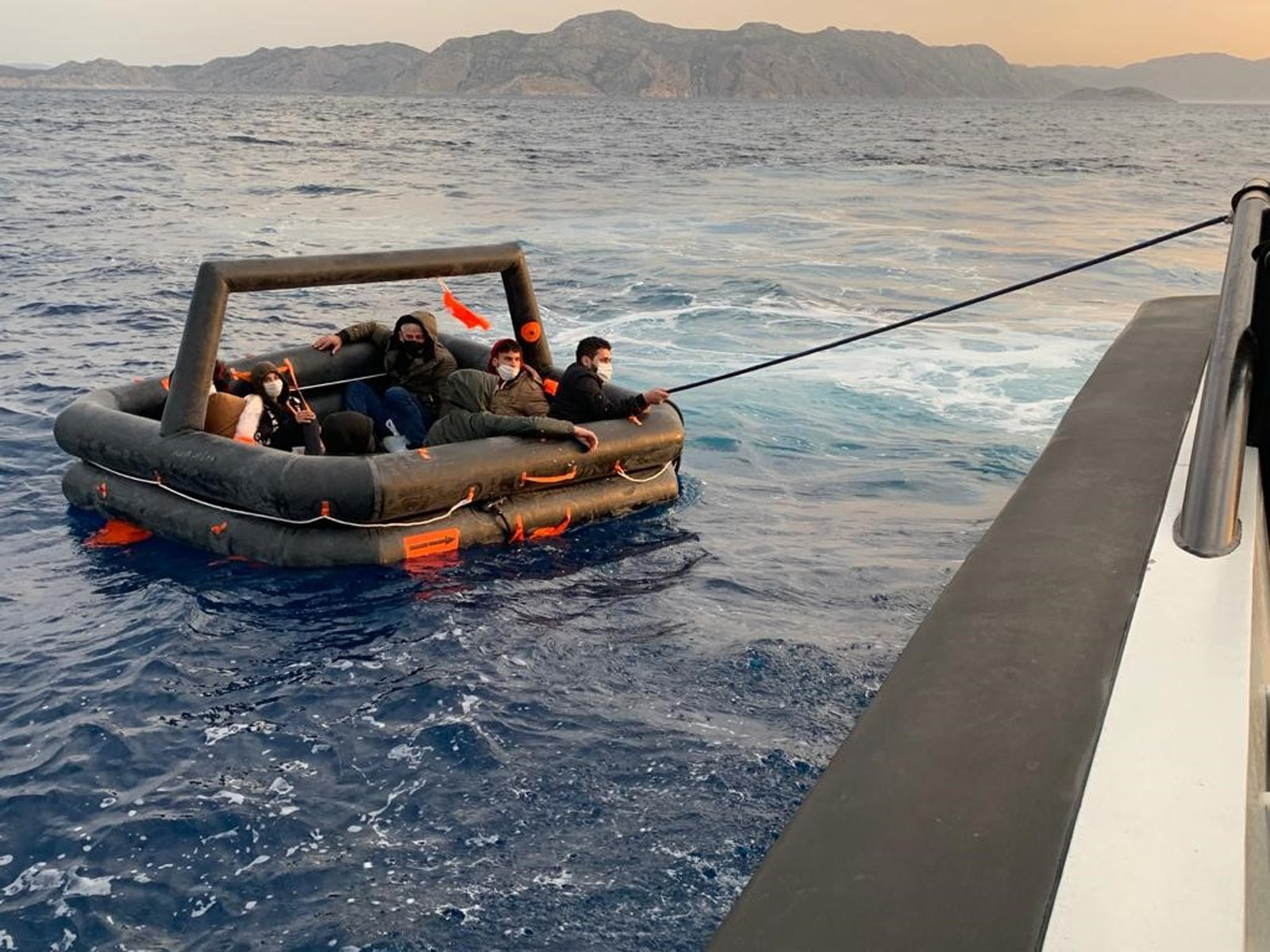 Asylum-seekers pushed back by Greece were saved by the Turkish coast guard off Muğla province's Marmaris district, Turkey, April 27, 2021. (DHA Photo)