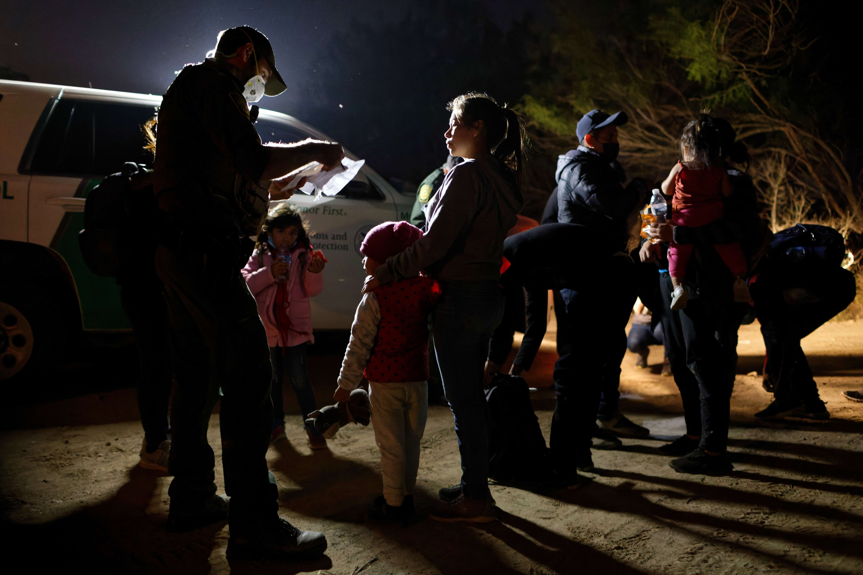 A U.S. border patrol agent registers immigrant families after they crossed the Rio Grande from Mexico, in Roma, Texas, U.S., April 27, 2021. (AP Photo)
