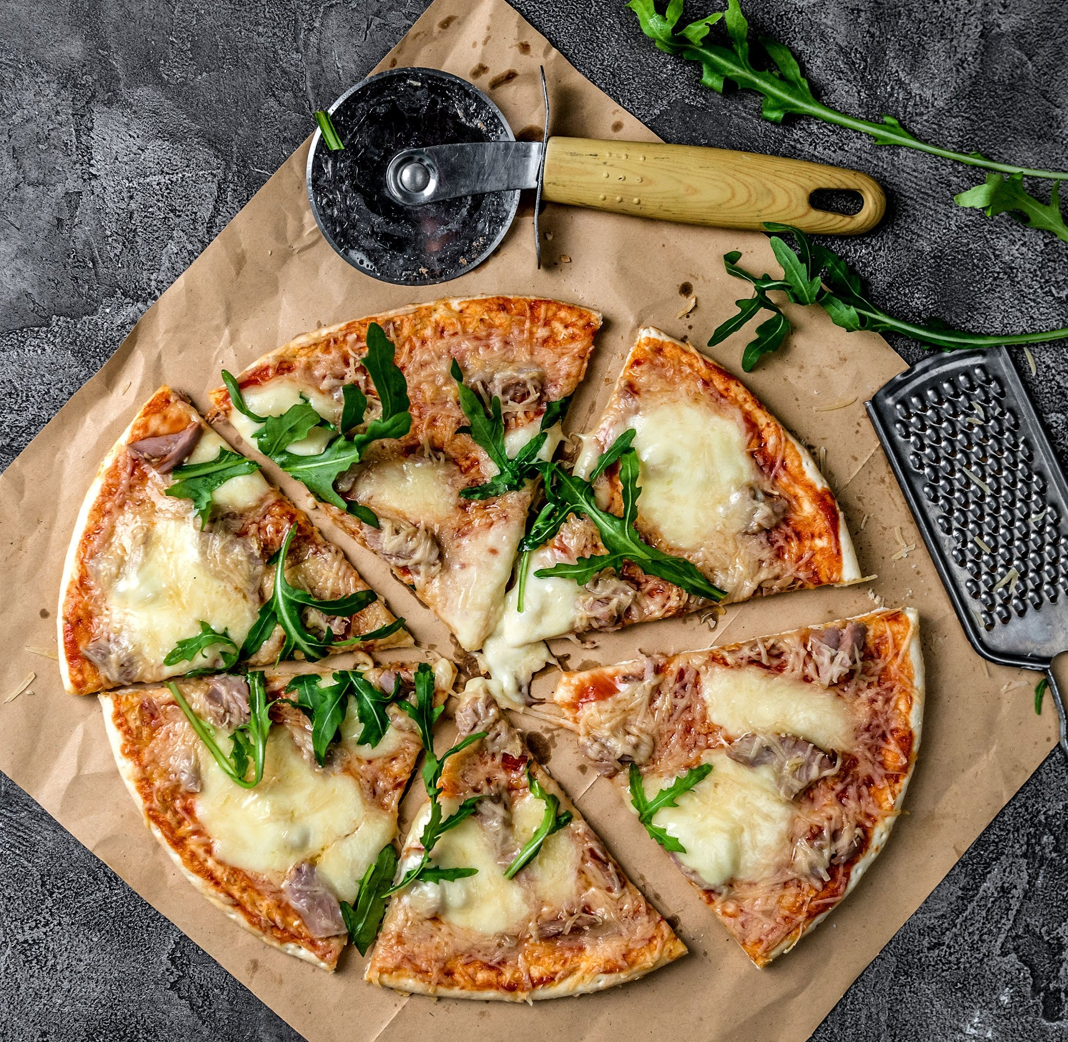 Tuna pairs beautifully with mozzarella cheese, parmesan and rocket on a pizza. (Shutterstock Photo)