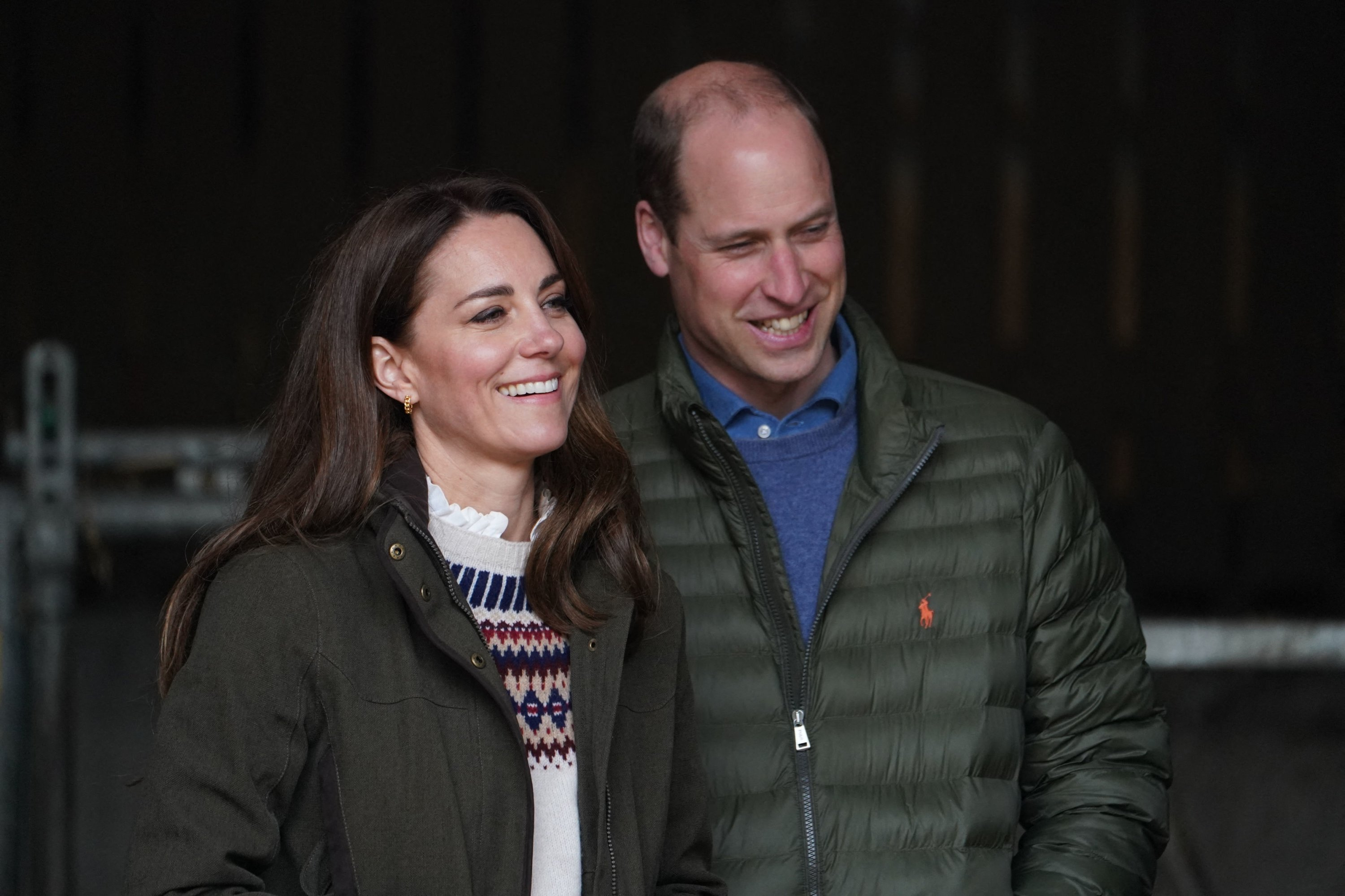 Catherine (L), Duchess of Cambridge, and Prince William, Duke of Cambridge, react during a visit to Manor Farm in Little Stainton, near Durham, northeast England, April 27, 2021. (AFP Photo)