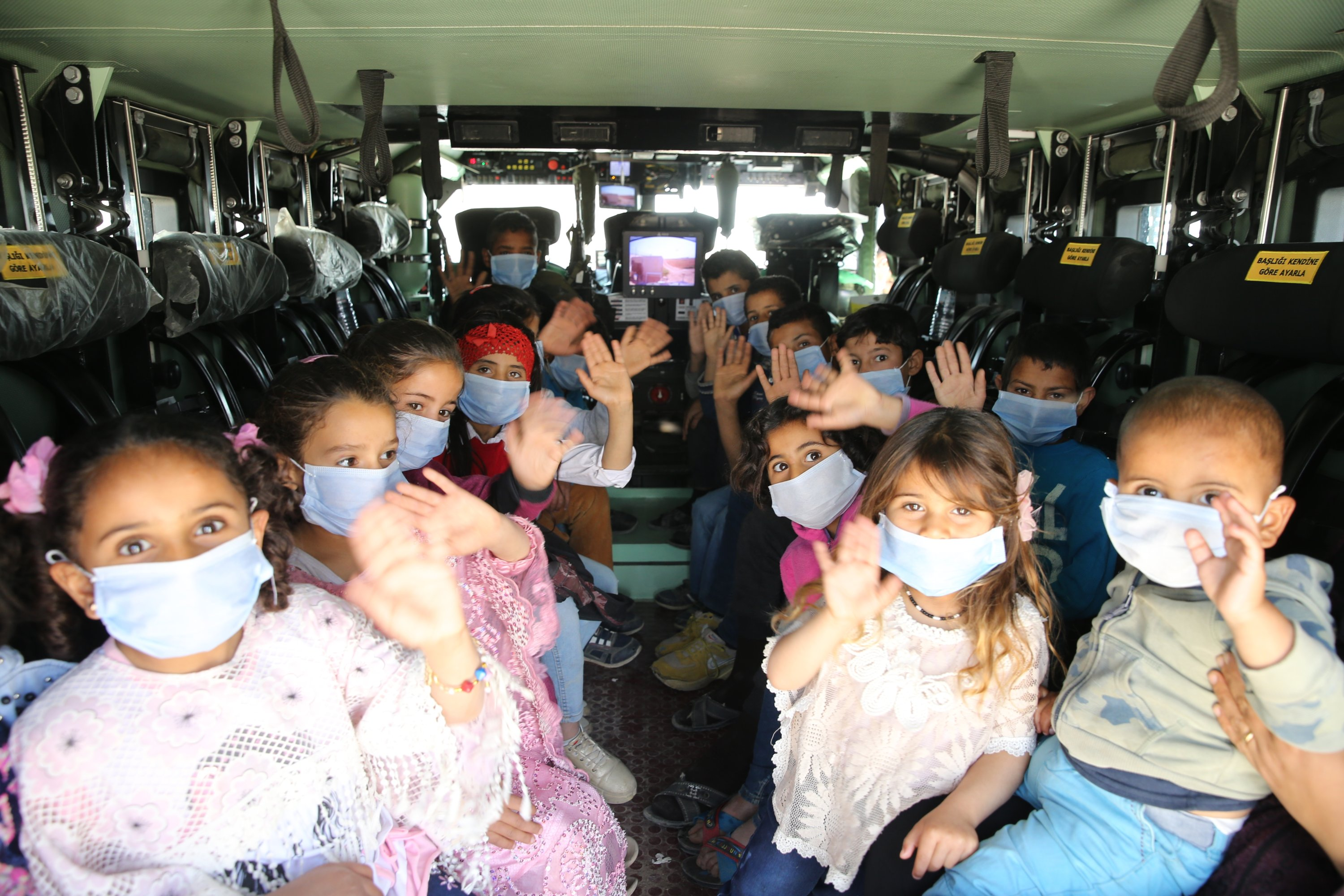 Syrian children in a Turkish armored vehicle on their way to Mardin, Turkey, April 28, 2021. (AA)