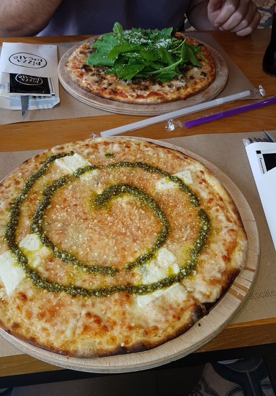 Pizza Locale's four-cheese pizza comes with pesto drizzled over the top. (Photo by Leyla Ergil)