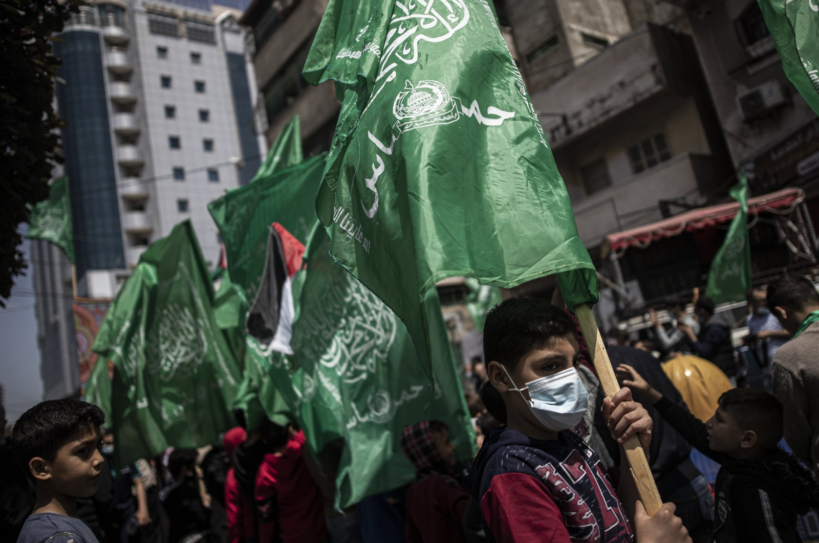 Hamas supporters hold the movement's green flags during a protest in solidarity with Palestinian demonstrators who have been clashing with Israeli police outside Jerusalem's Old City following the closure of a popular Ramadan gathering spot, in Gaza City, April 23, 2021. (AP Photo)
