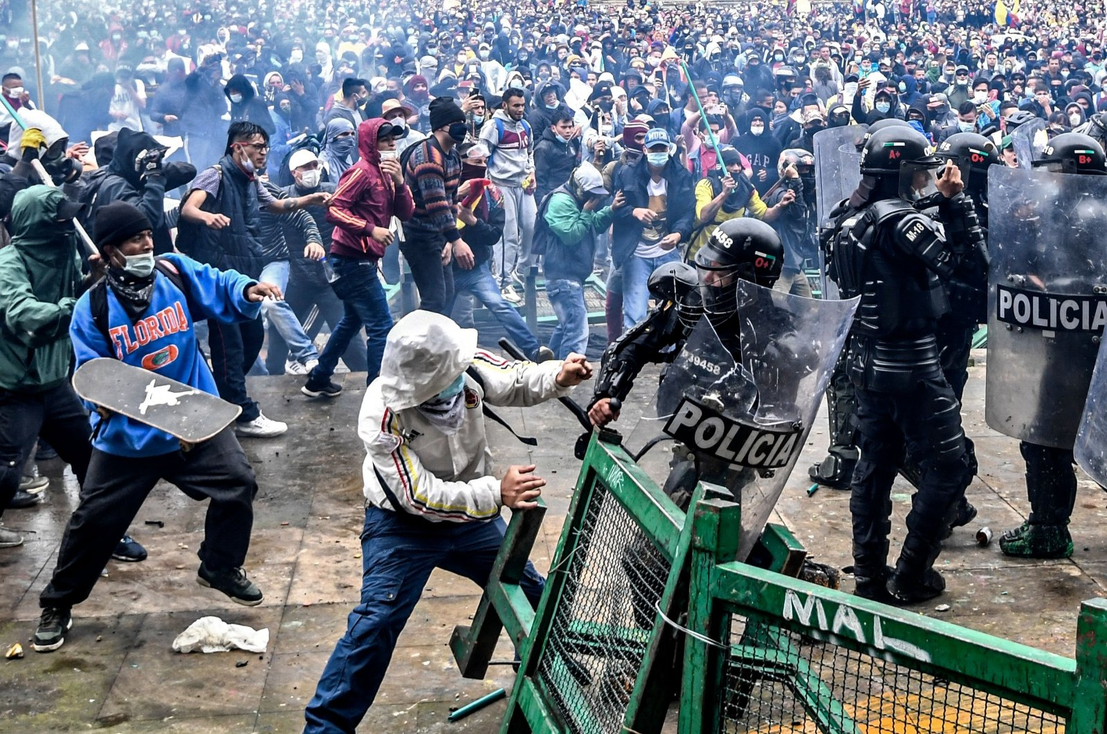 Demonstrators clash with riot police during a protest against a tax reform bill launched by Colombian President Ivan Duque, Bogota, Colombia, April 28, 2021. (AFP Photo)