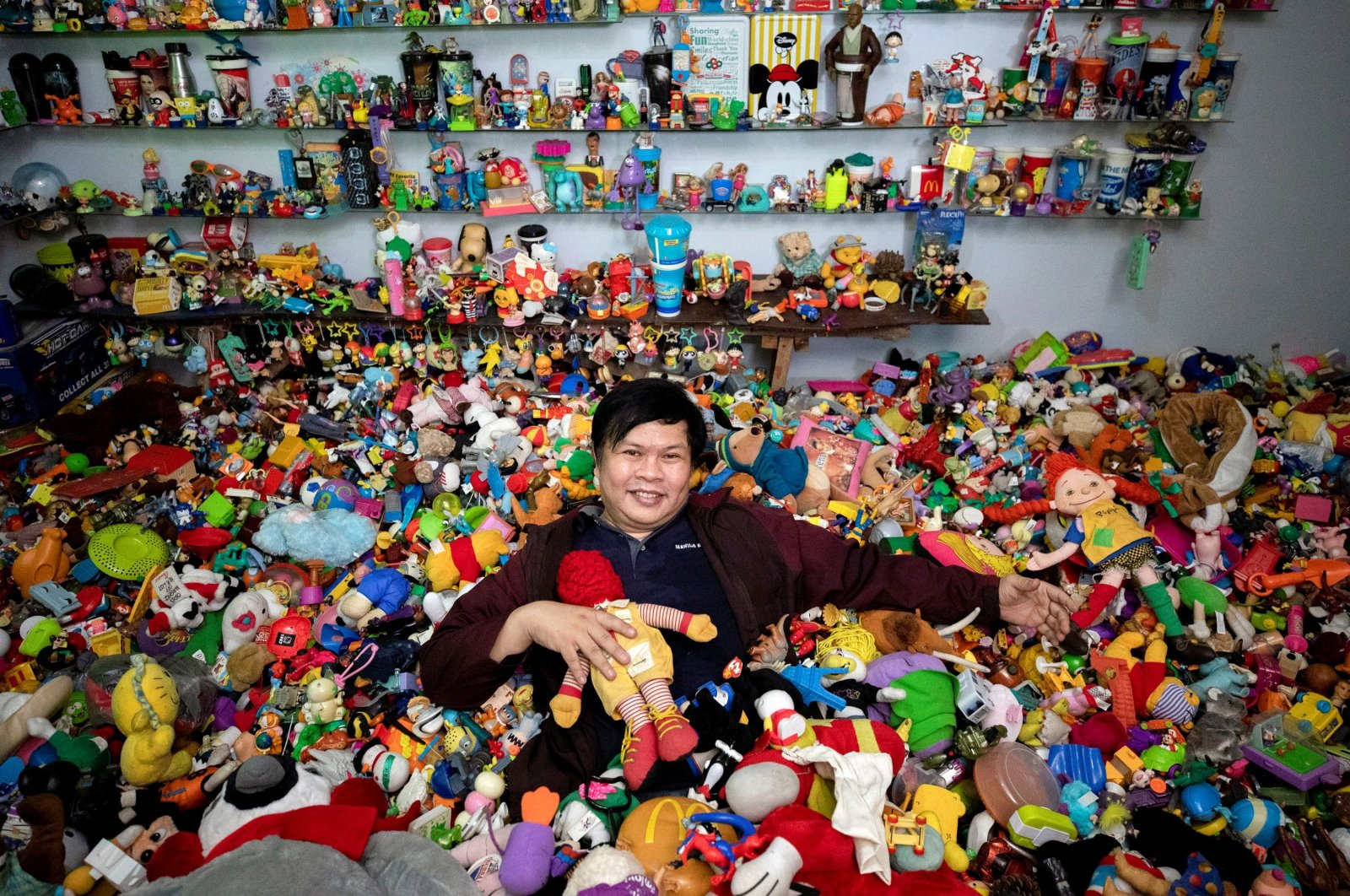 Percival Lugue, who has the Guinness world record for the largest fast-food toy collection, poses with his toy collection in his home in Apalit, Pampanga province, Philippines, April 20, 2021. (REUTERS Photo)