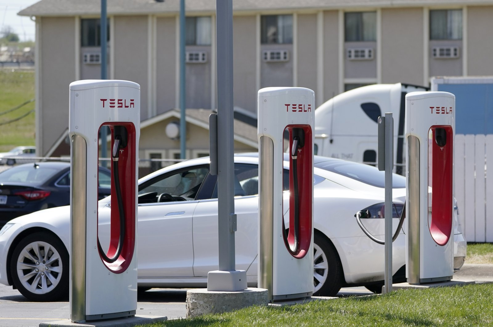 A Tesla electric vehicle charges at a station in Topeka, Kansas, U.S., April 5, 2021. (AP Photo)