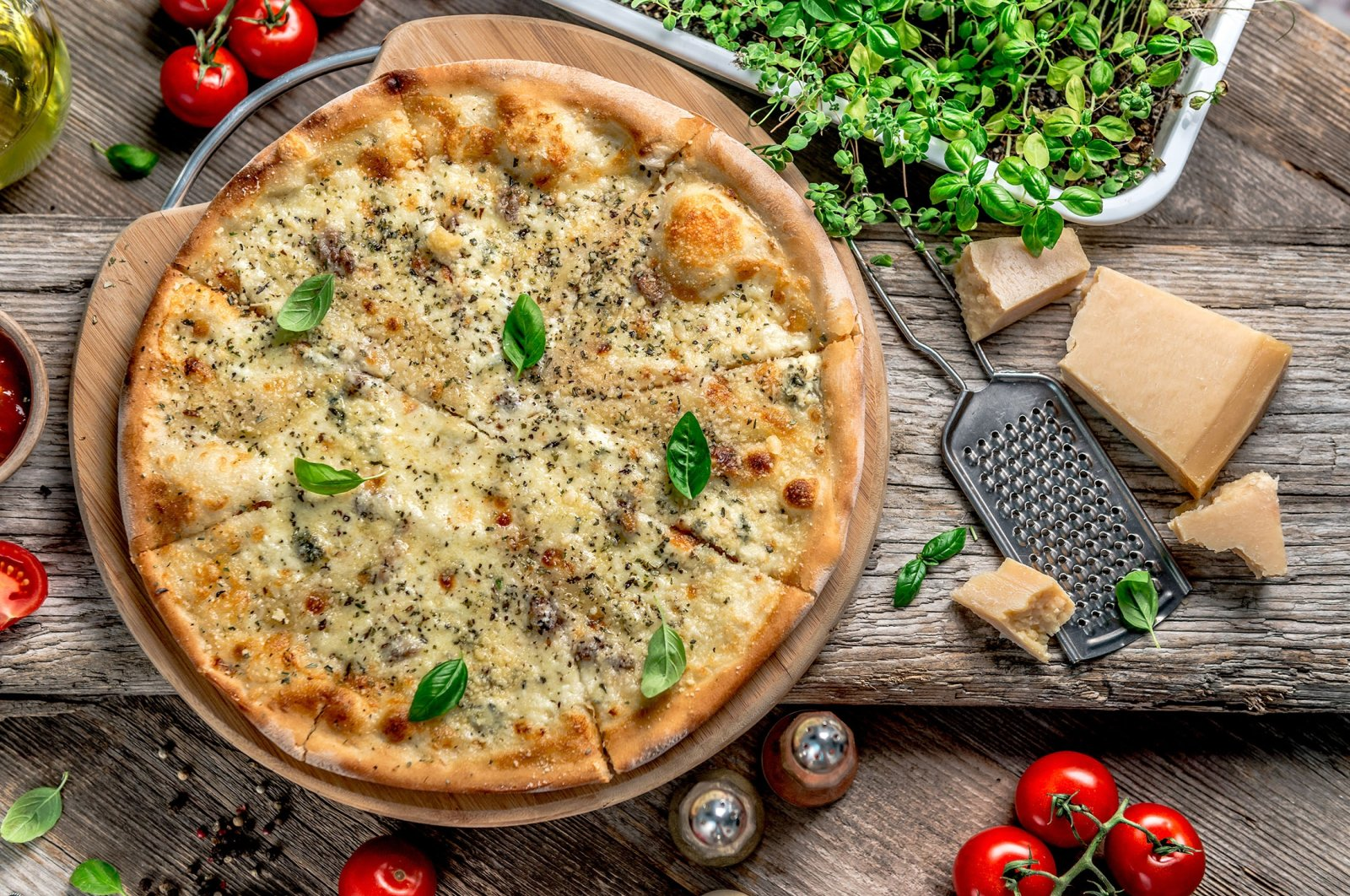Pizza quattro formaggi, or four cheese pizza, is an iconic item on many menus. (Shutterstock Photo)