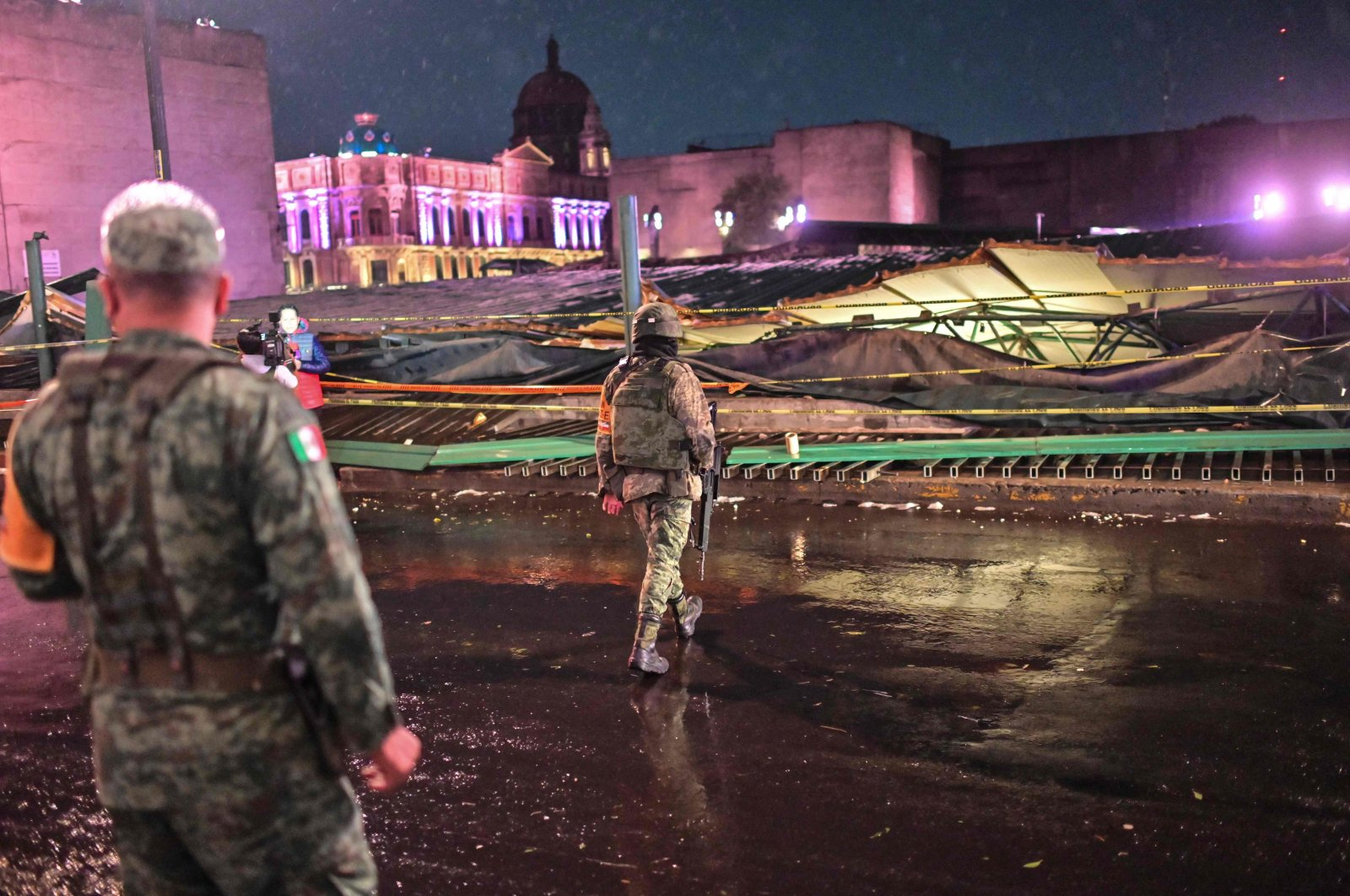 """Mexicans soldiers stand guard next to the Aztec archaeological zone of """"Templo mayor"""" affected by heavy rain, in Mexico City, Mexico, April 28, 2021. (AFP Photo)"""