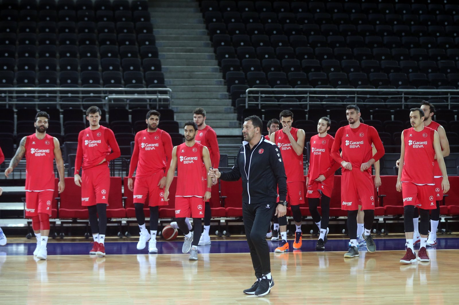 The Turkish men's national basketball team train alongside coach Ufuk Sarıca (C) ahead of the FIBA 2021 qualifiers in Ankara, Turkey, Feb. 18, 2021.(AA File Photo)