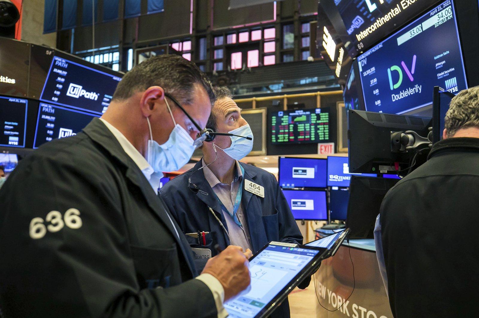 Traders work on the floor of the New York Stock Exchange, New York, U.S., April 21, 2021 (Courtney Crow/New York Stock Exchange via AP)
