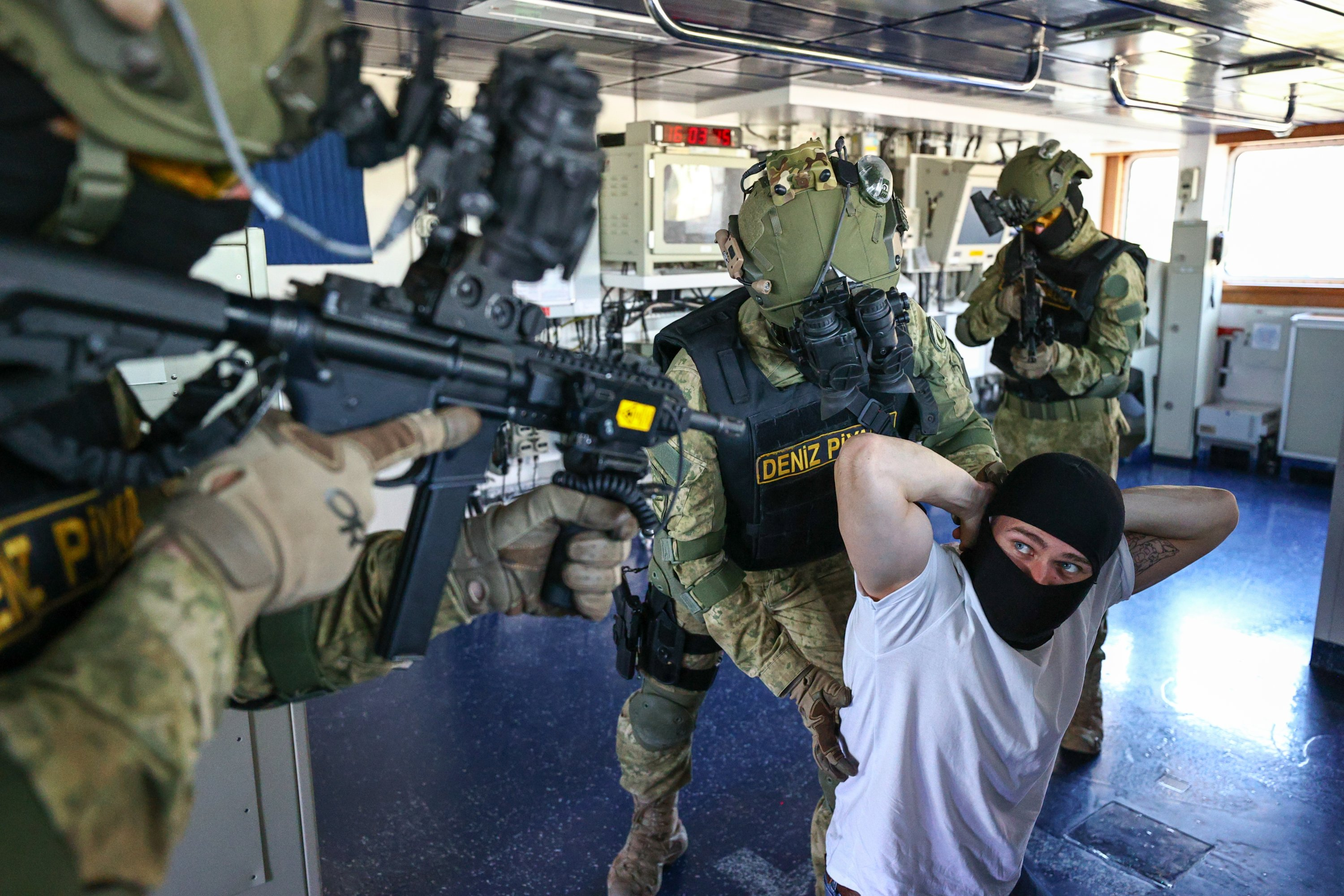 Marines neutralize 'hijackers' aboard the vessel during training, in Izmir, western Turkey, April 29, 2021. (AA PHOTO)