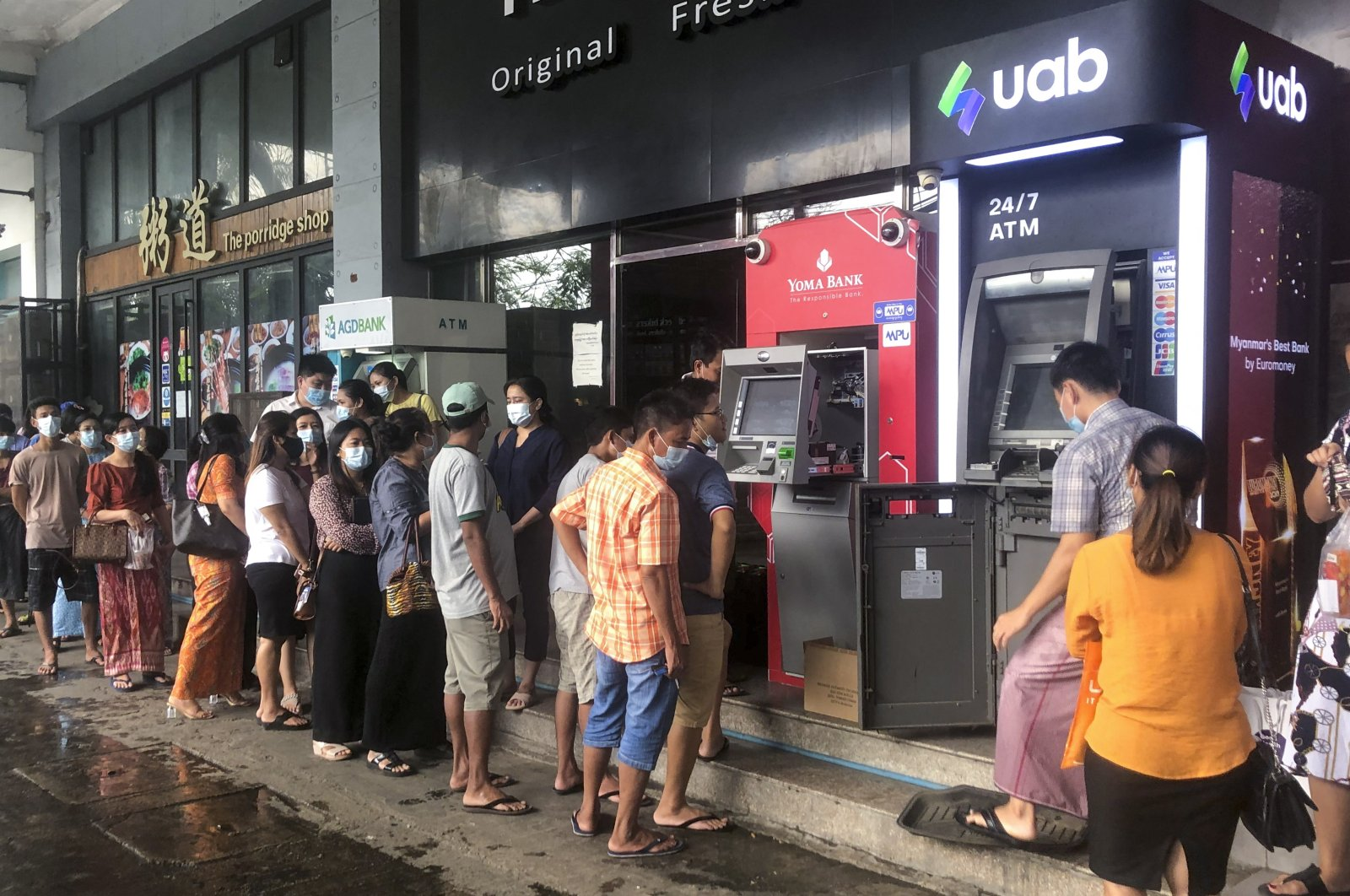People wait near ATM machines to withdraw cash in Yangon, Myanmar, April 29, 2021. (EPA Photo)
