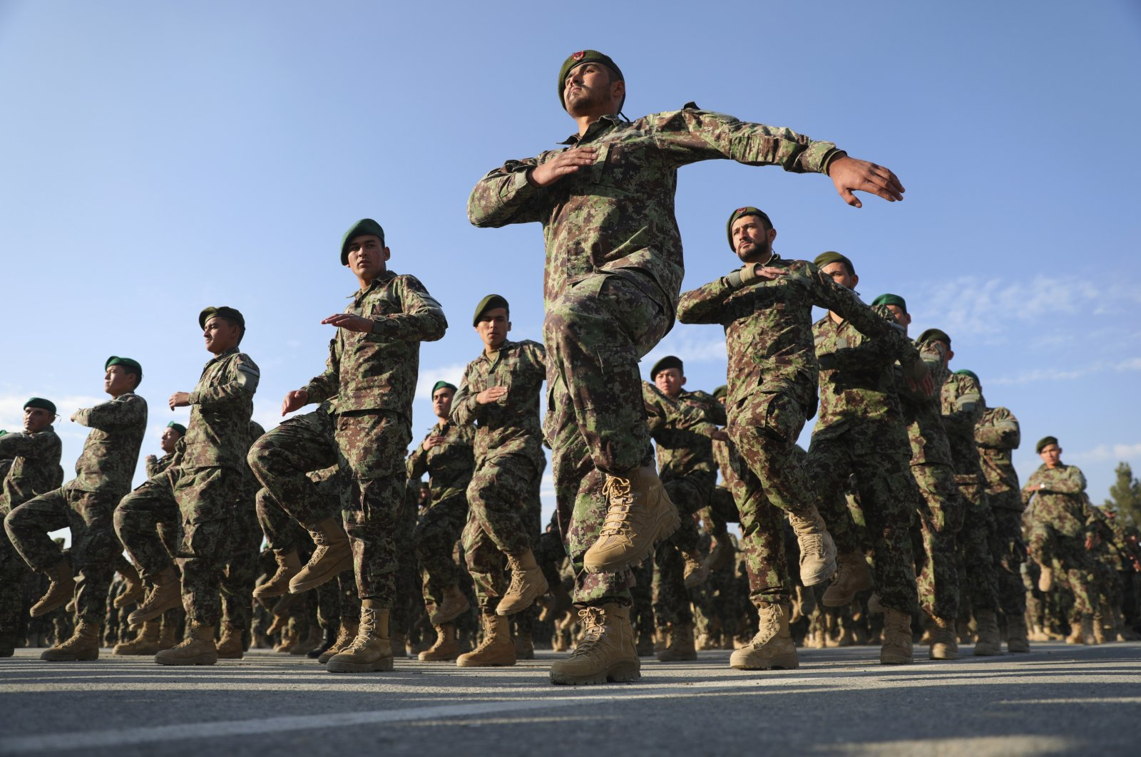 Newly graduated Afghan National Army march during their graduation ceremony after a three-month training program at the Afghan Military Academy in Kabul, Afghanistan, Nov. 29, 2020. (AP Photo)